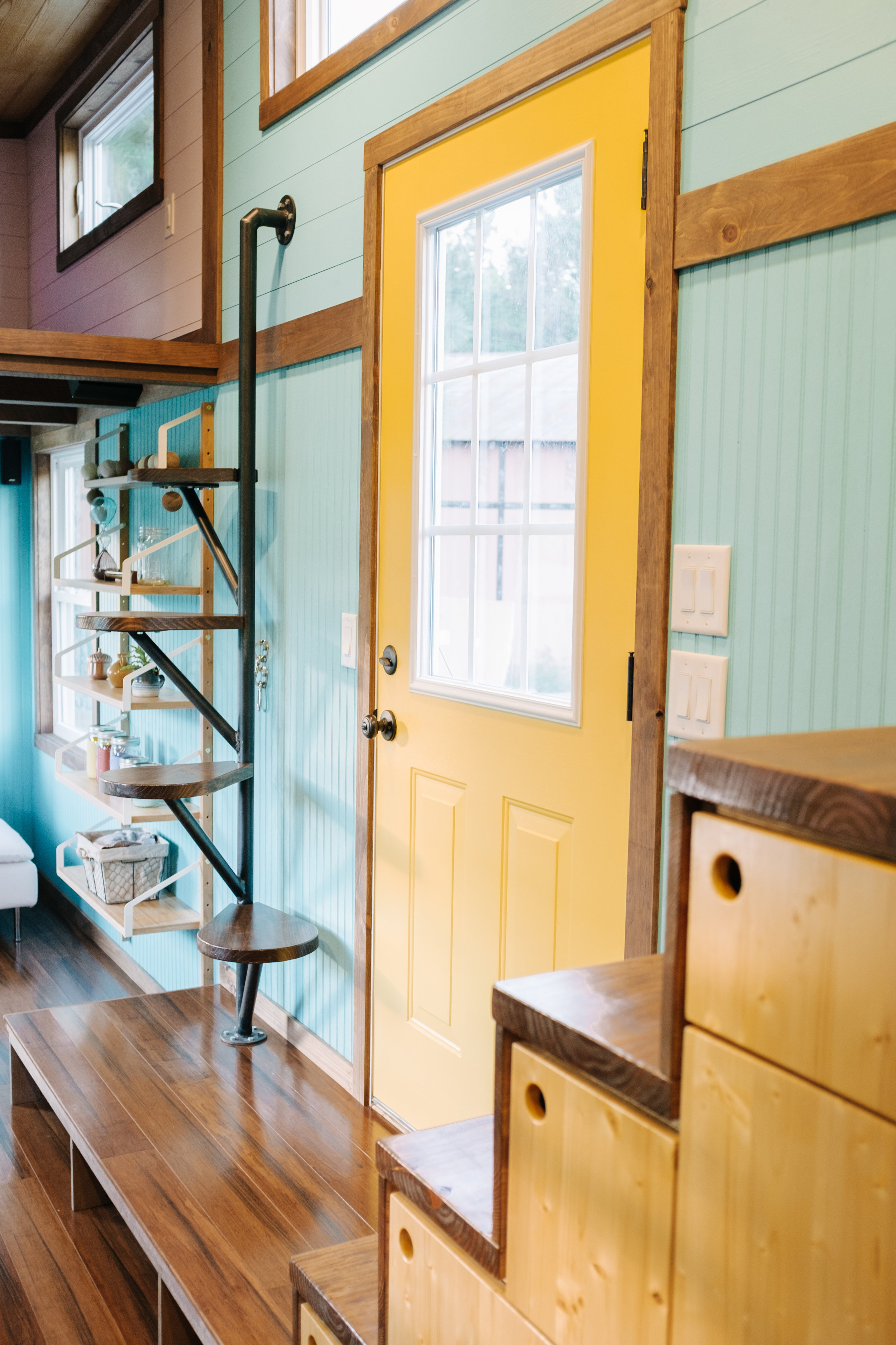 The Big Whimsy by Wind River Tiny Homes - built in storage shelving, cat door, litter box cubby with vent fan,custom lily pad spiral stairs, bamboo flooring