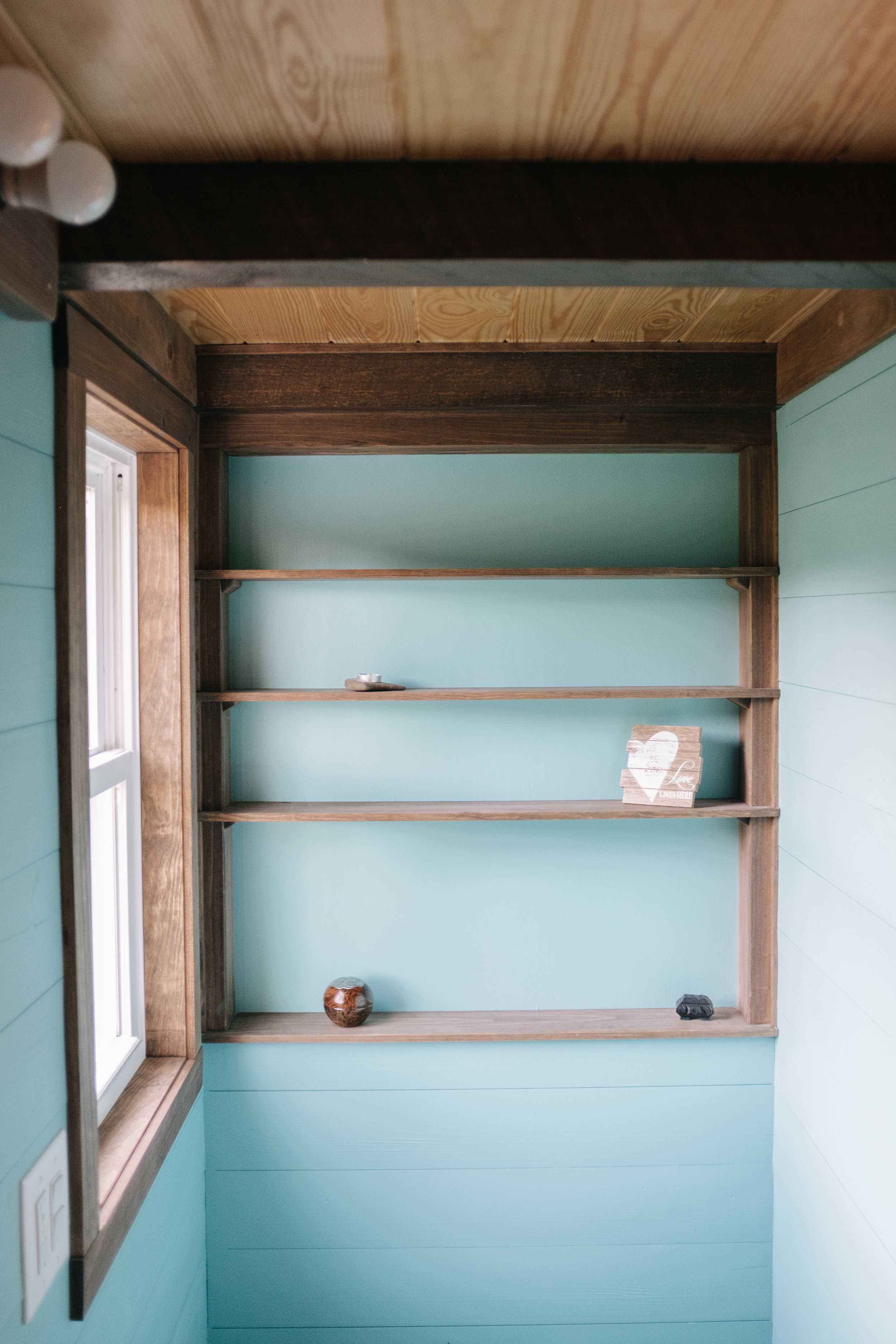 The Big Whimsy by Wind River Tiny Homes - bathroom shelving, natures head composting toilet