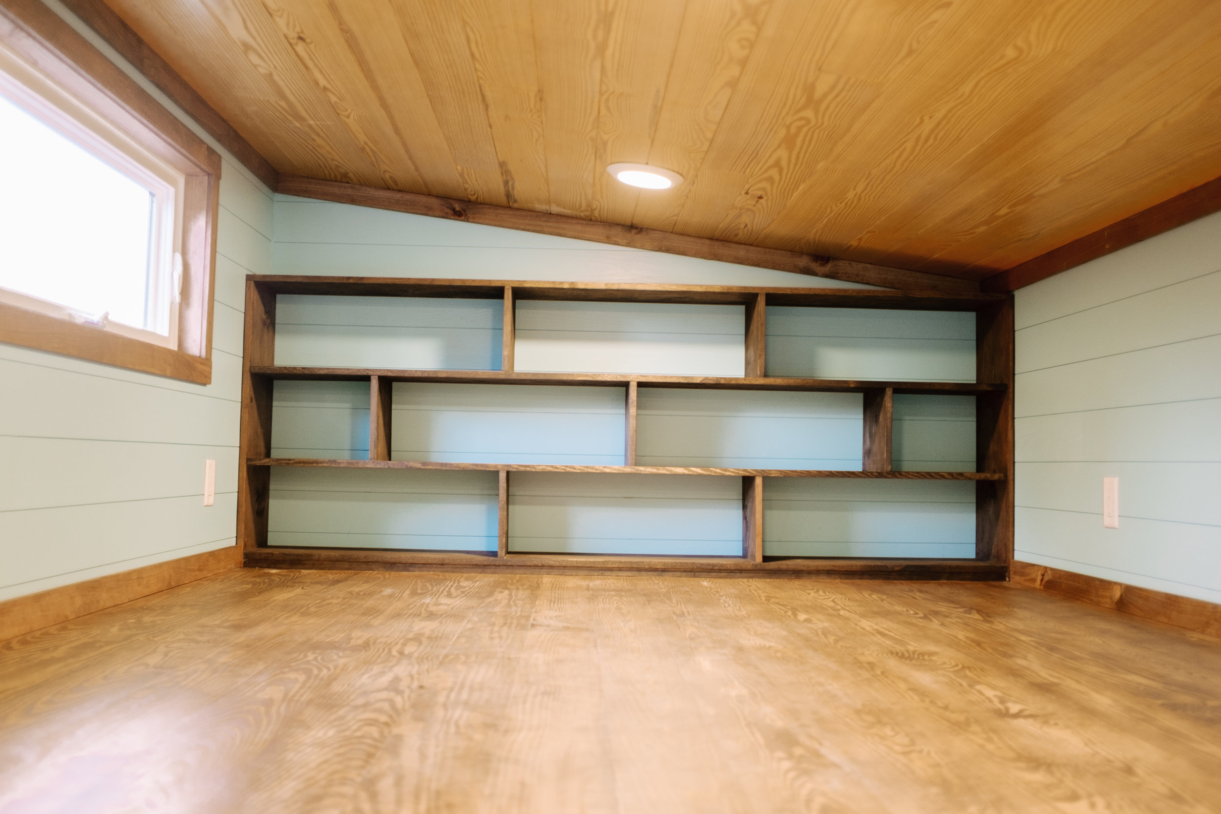 The Big Whimsy by Wind River Tiny Homes - 10' primary loft, open cubby shelving, natural yellow pine ceiling, LED flush lights