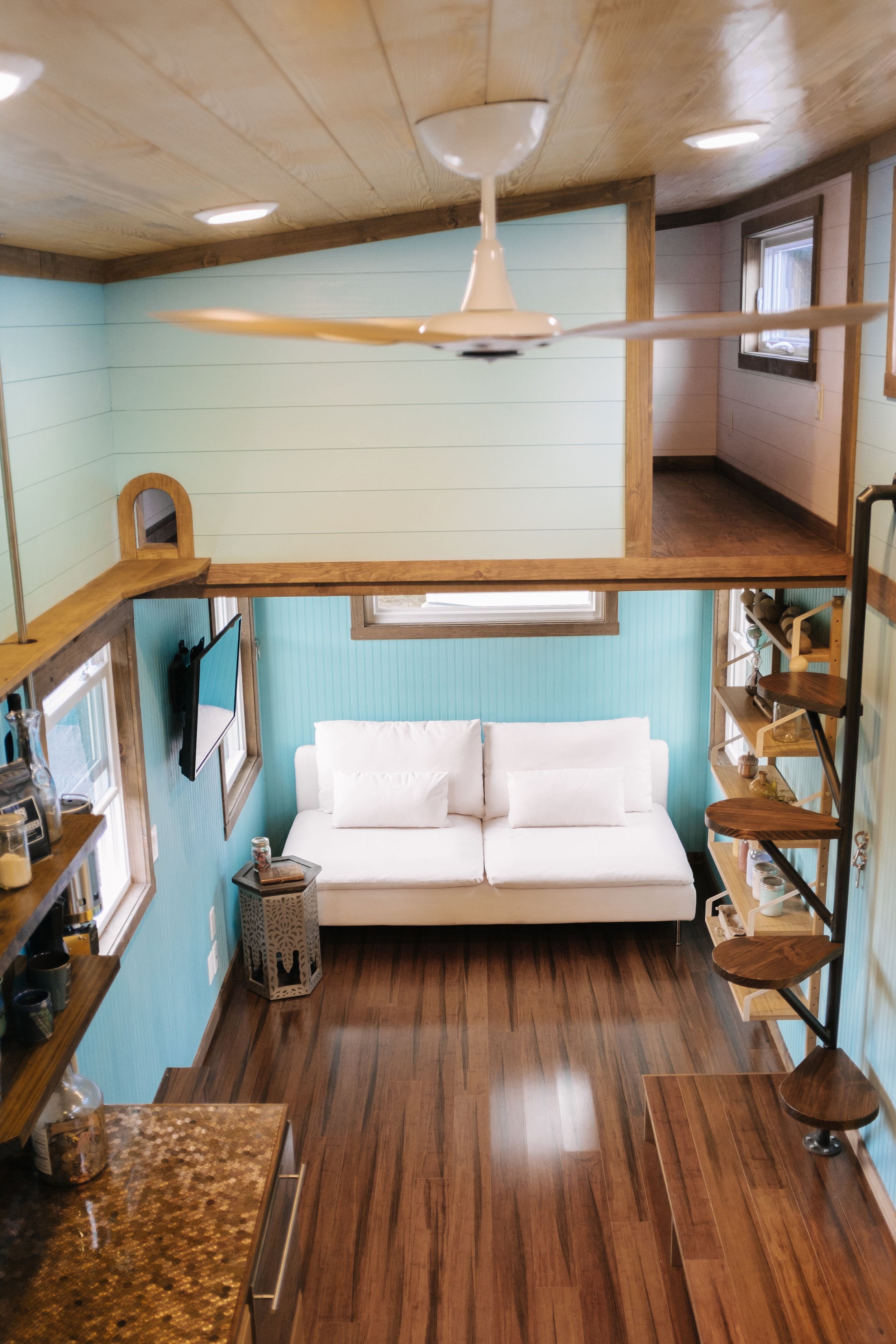 The Big Whimsy by Wind River Tiny Homes - Haiku ceiling fan, custom lily pad spiral stairs, cat walk between lofts, bamboo flooring, built in storage stairs