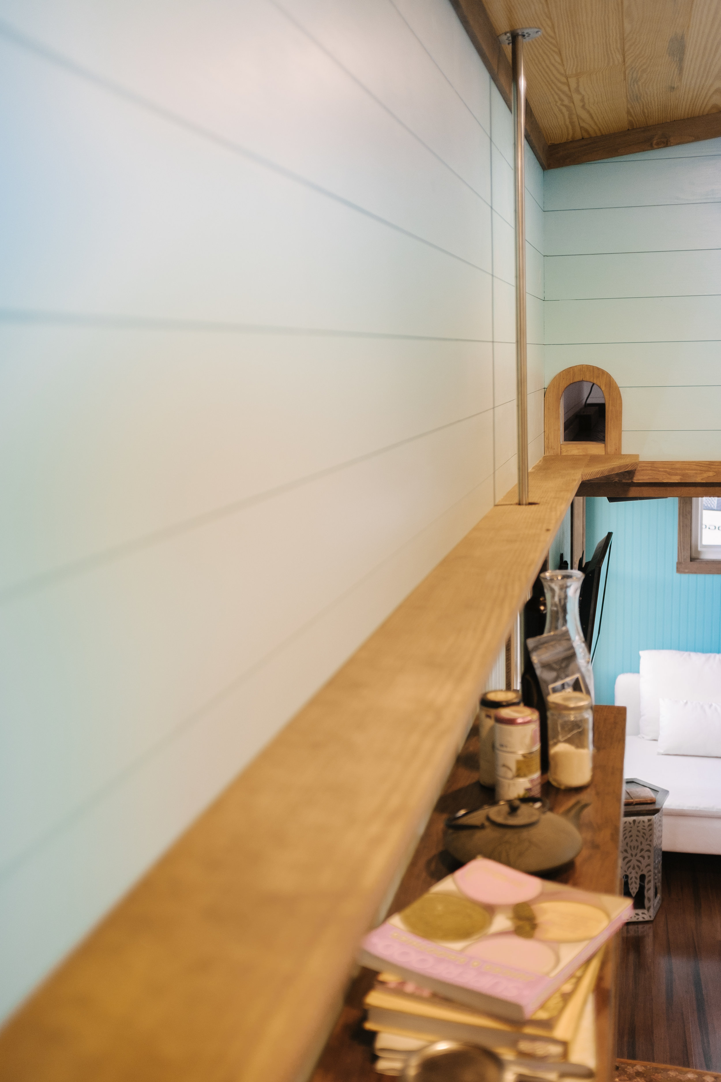 The Big Whimsy by Wind River Tiny Homes -cat walk between lofts