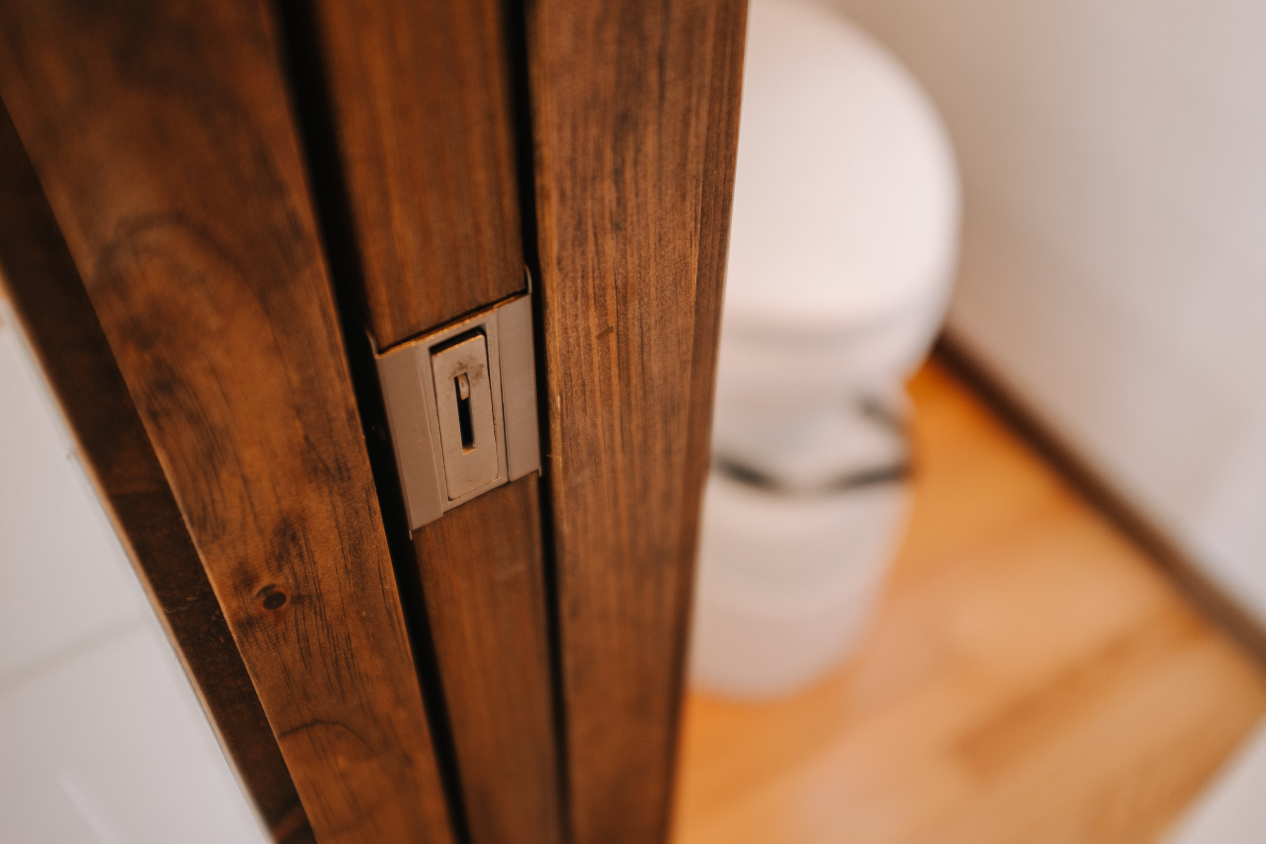 The Acadia by Wind River Tiny Homes - tiny house, pocket door, Natures Head composting toilet
