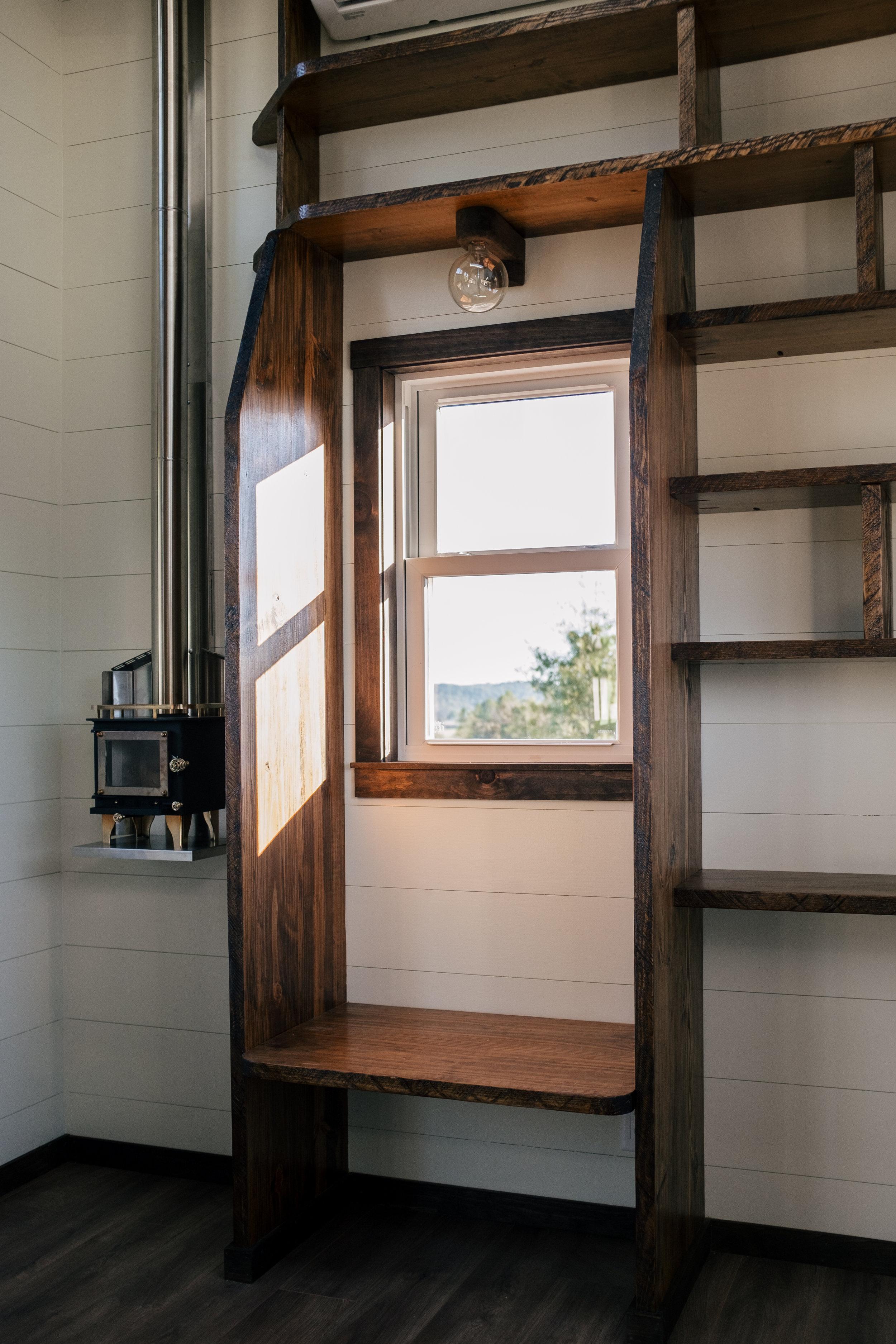 The Silhouette by Wind River Tiny Homes - ship lap, LED edison bulb light fixture, Cubic Mini wood stove
