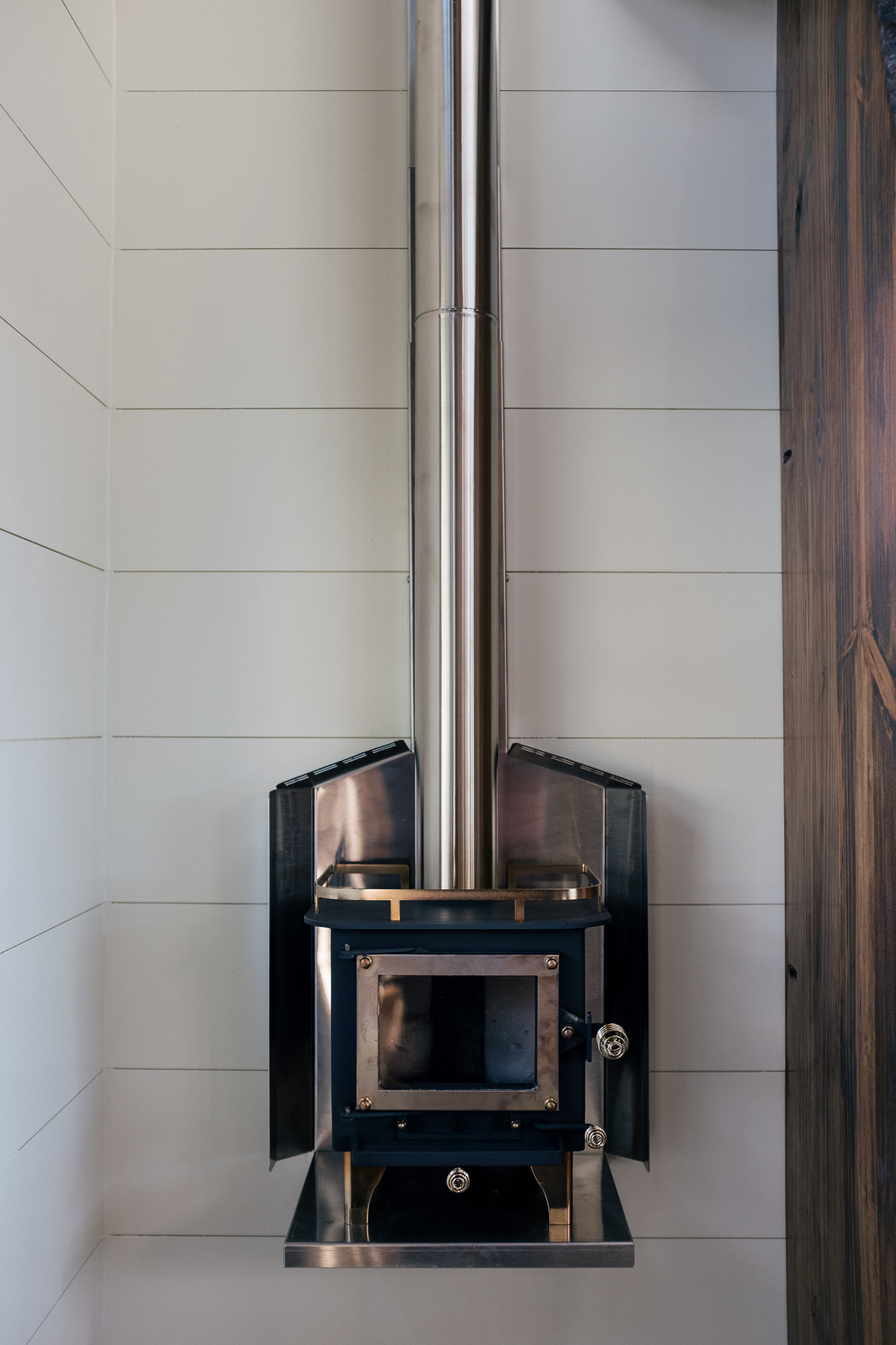 The Silhouette by Wind River Tiny Homes - ship lap, Cubic Mini wood stove