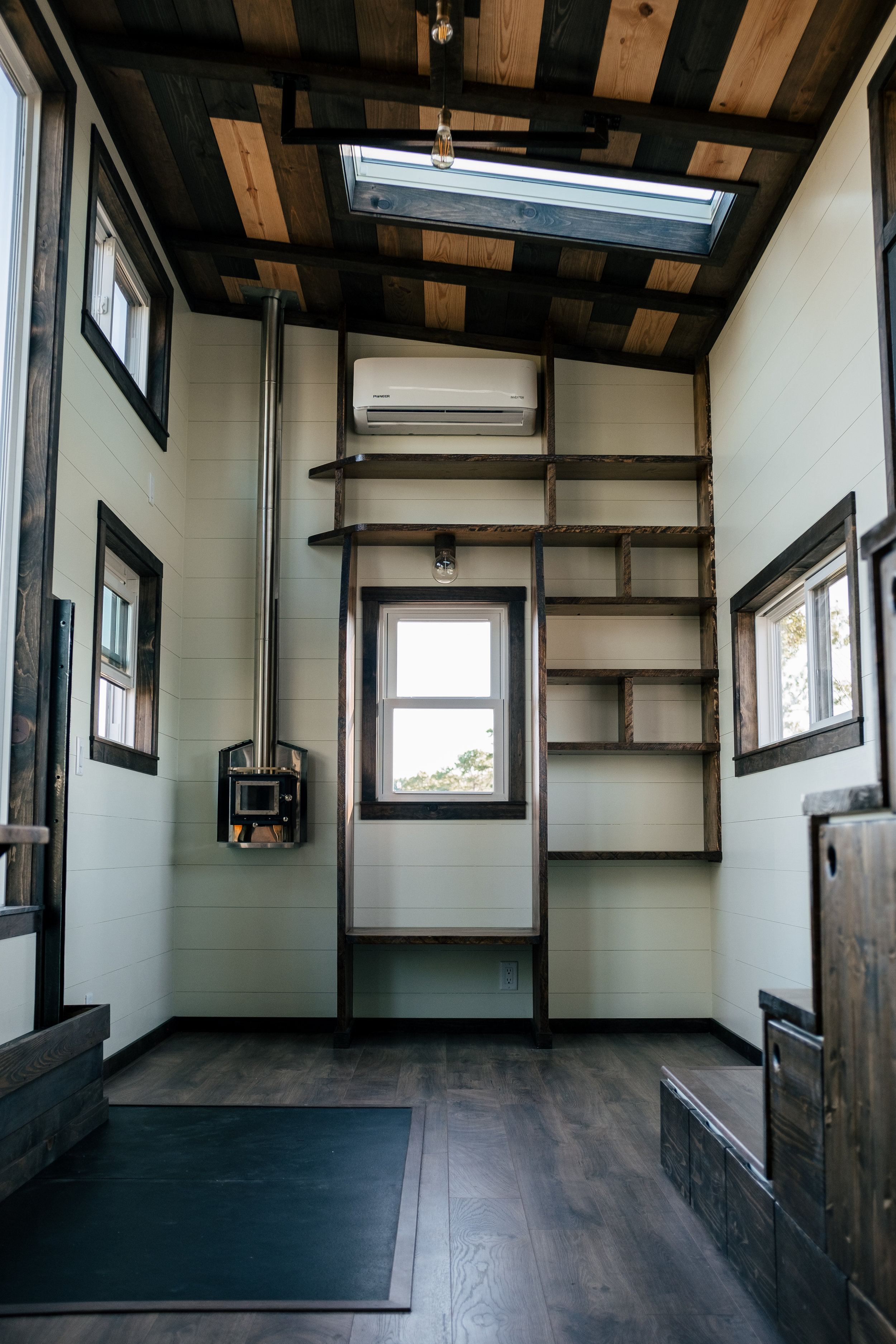 The Silhouette by Wind River Tiny Homes - ship lap,storage stairs, Cubic Mini wood stove