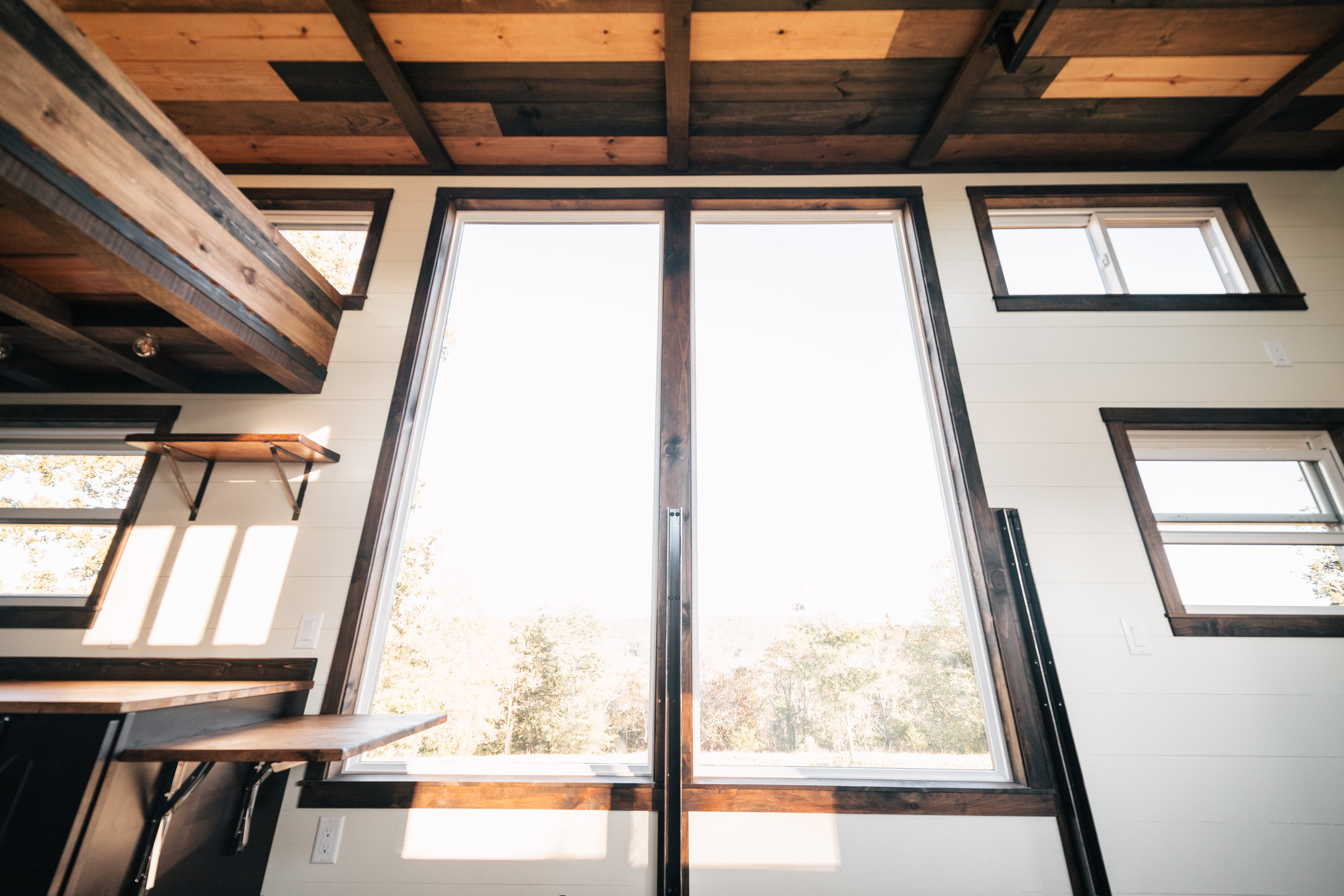 The Silhouette by Wind River Tiny Homes - ship lap, skylight, storage stairs, LED edison bulb light fixture