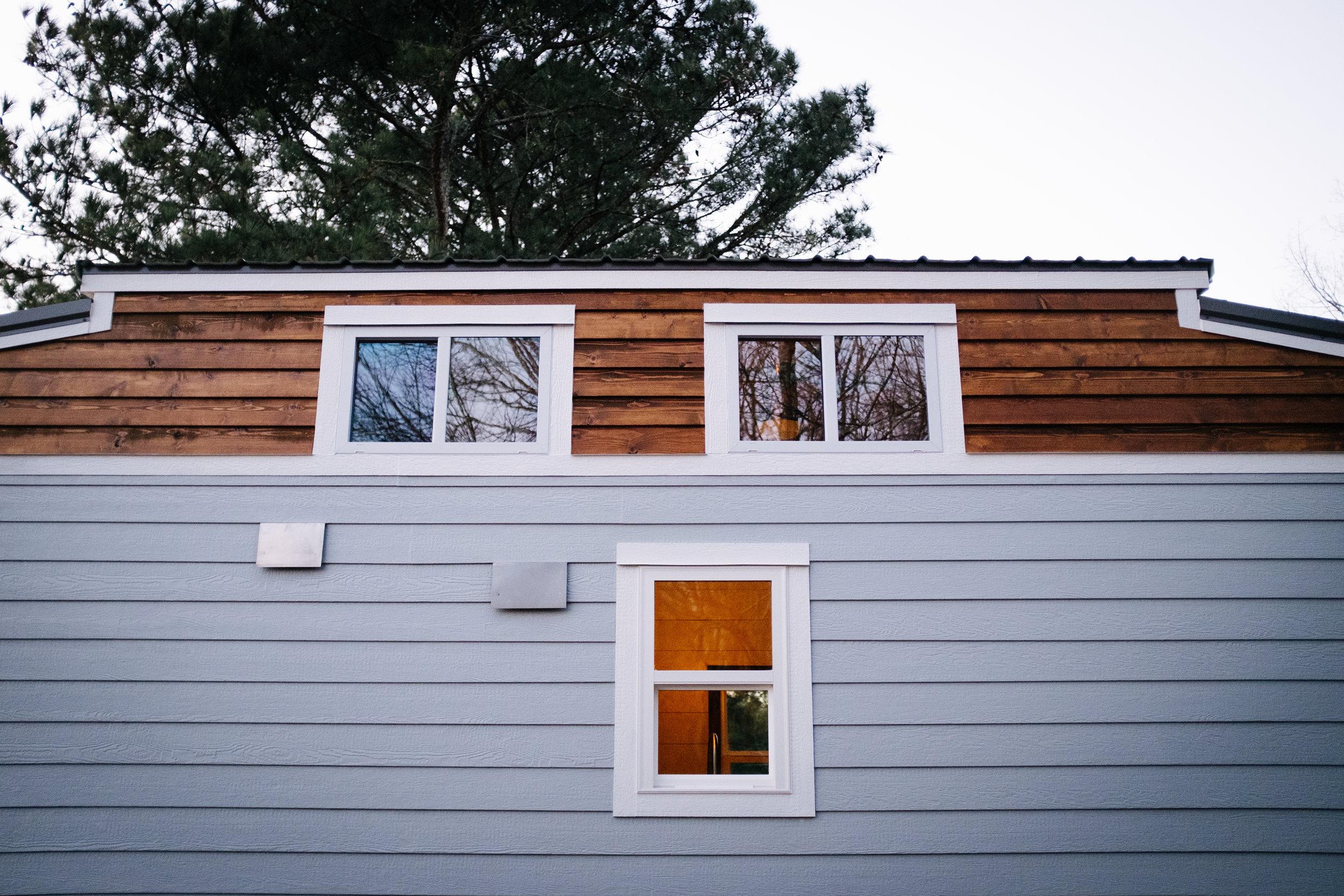The Noah by Wind River Tiny Homes - cedar lap siding, LP smartsiding, craftsman home