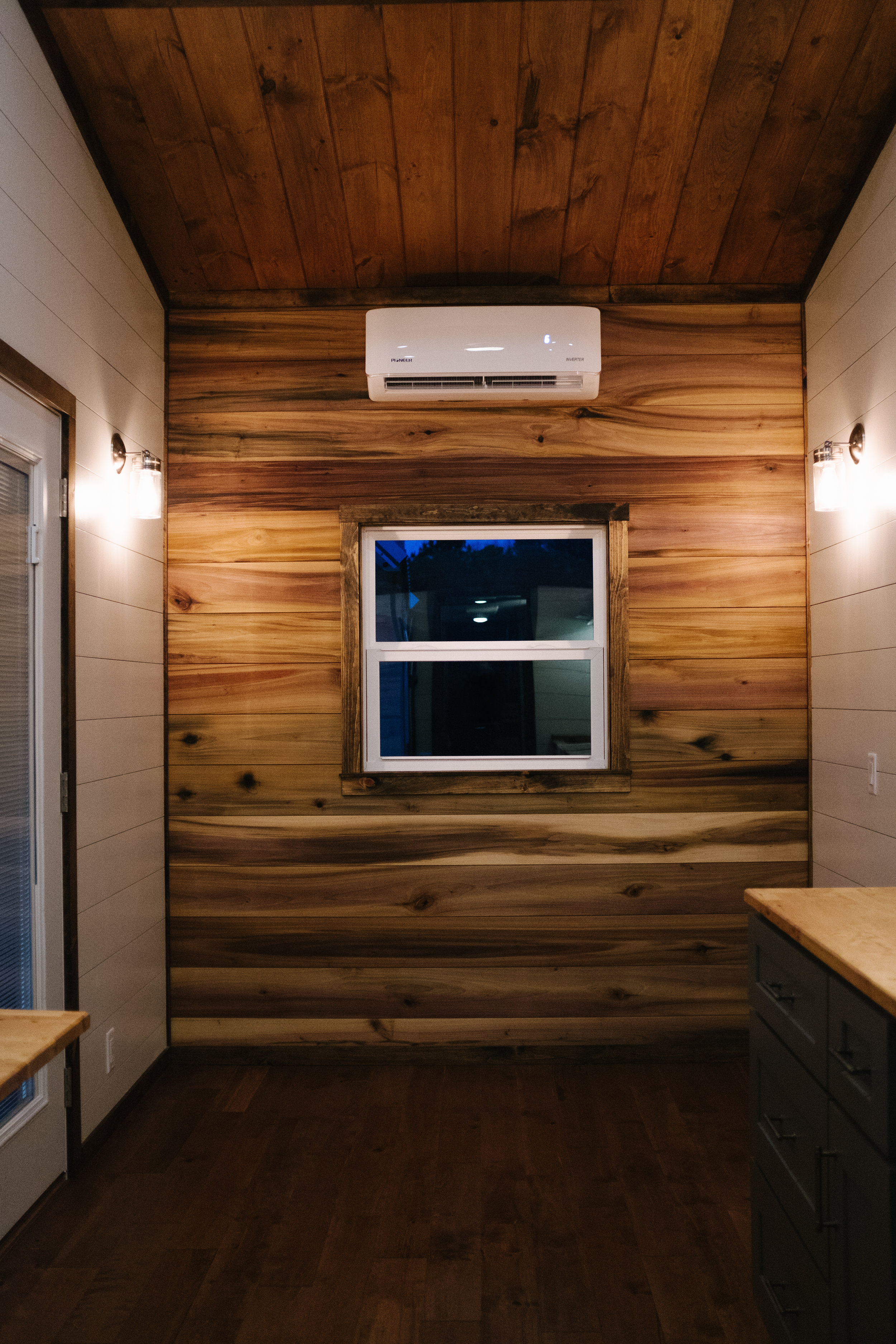The Noah by Wind River Tiny Homes - natural poplar accent wall, shiplap, birch hardwood flooring