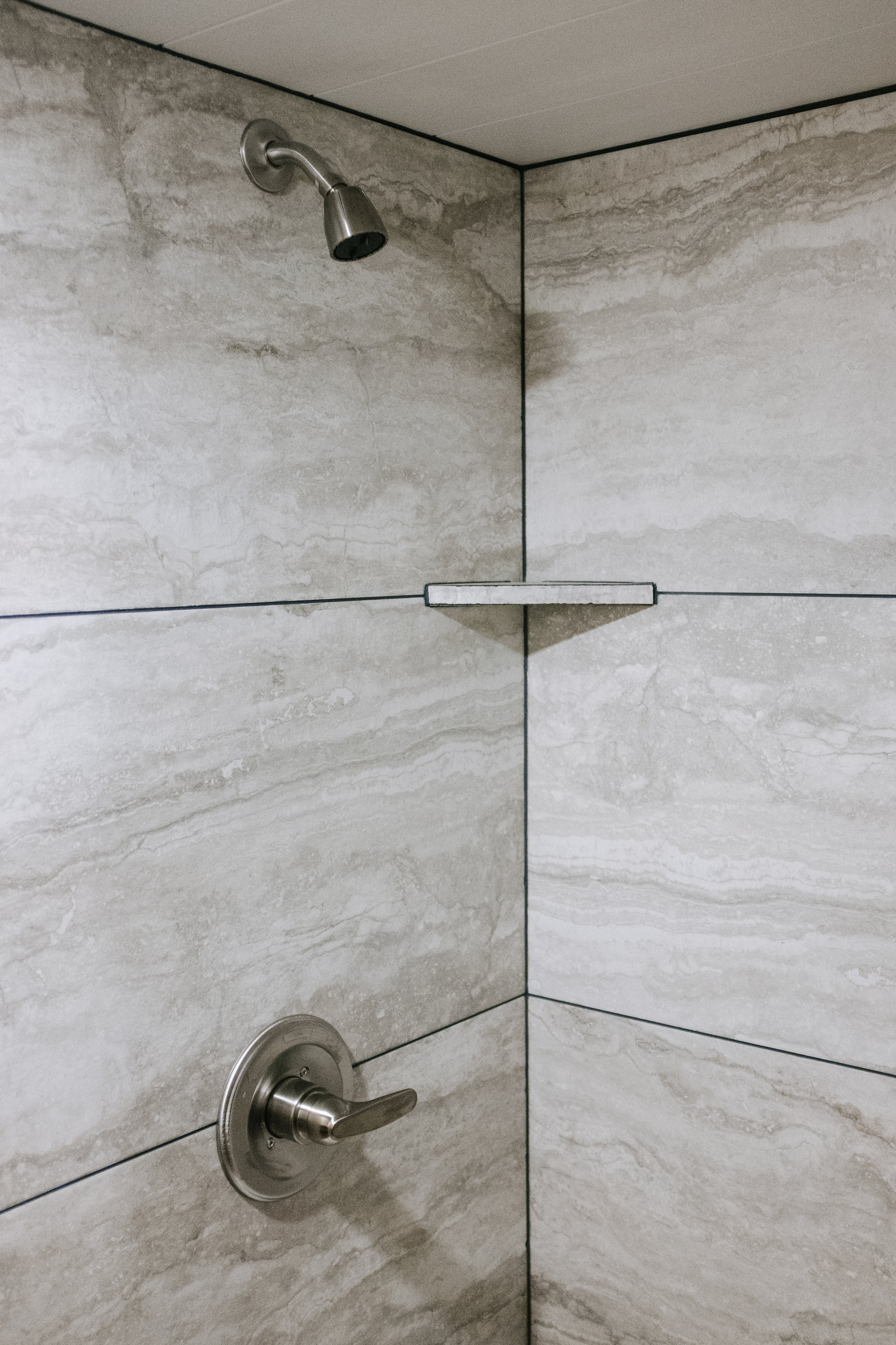 The Noah by Wind River Tiny Homes - tile shower, brushed nickel shower trim