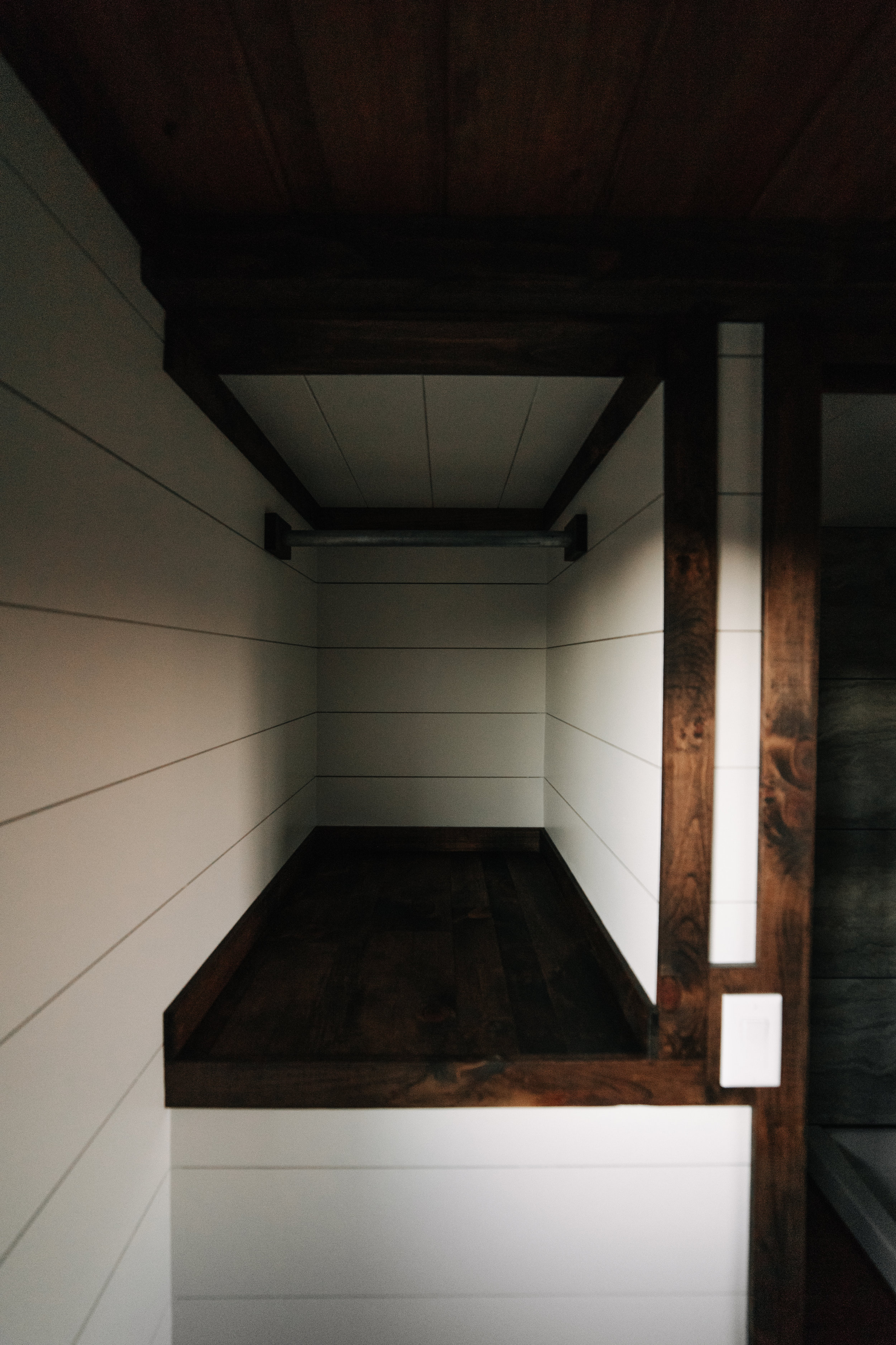 The Noah by Wind River Tiny Homes - compact closet space, shiplap