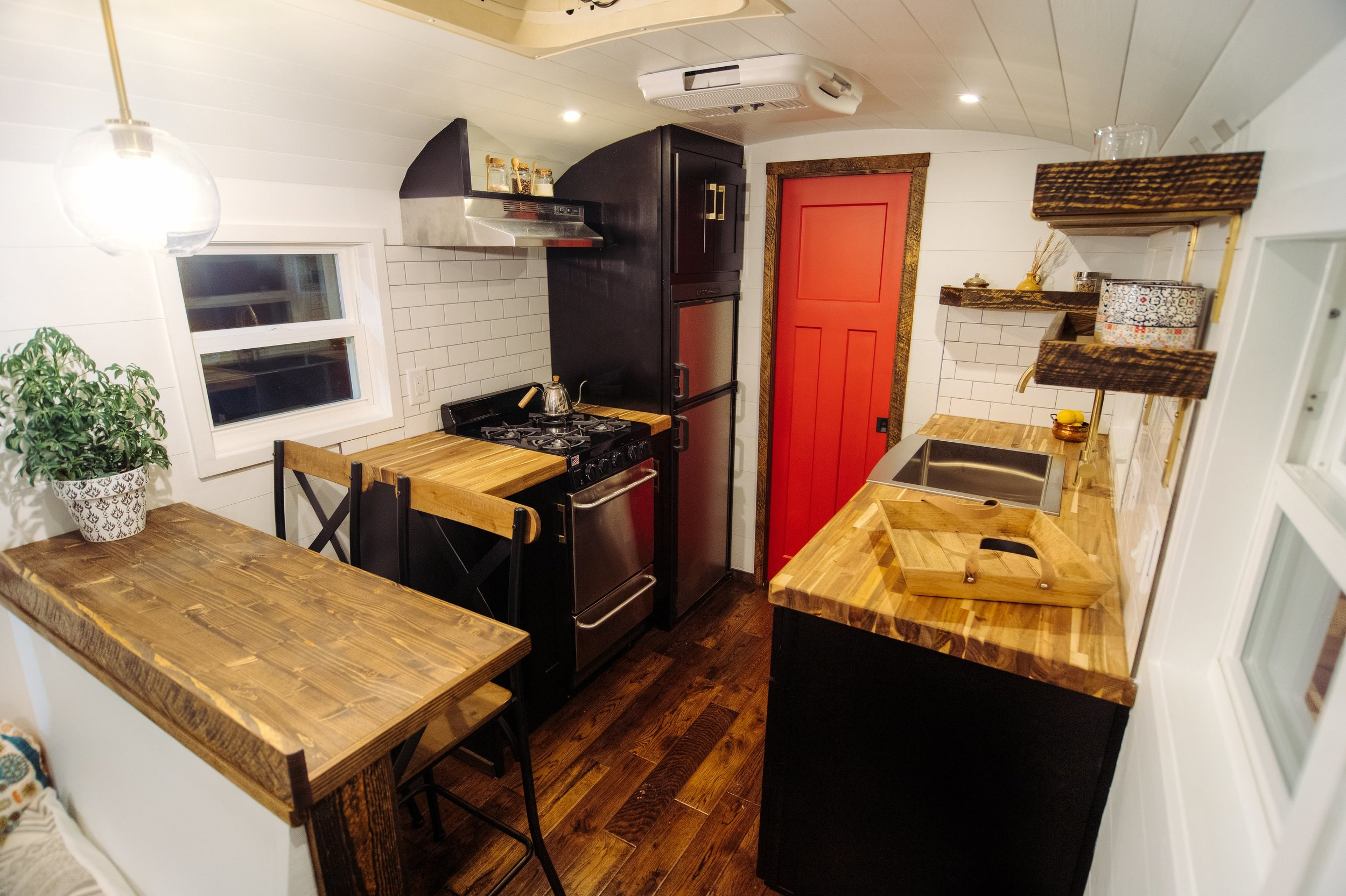 The Greyhound Skoolie by Wind River Tiny Homes