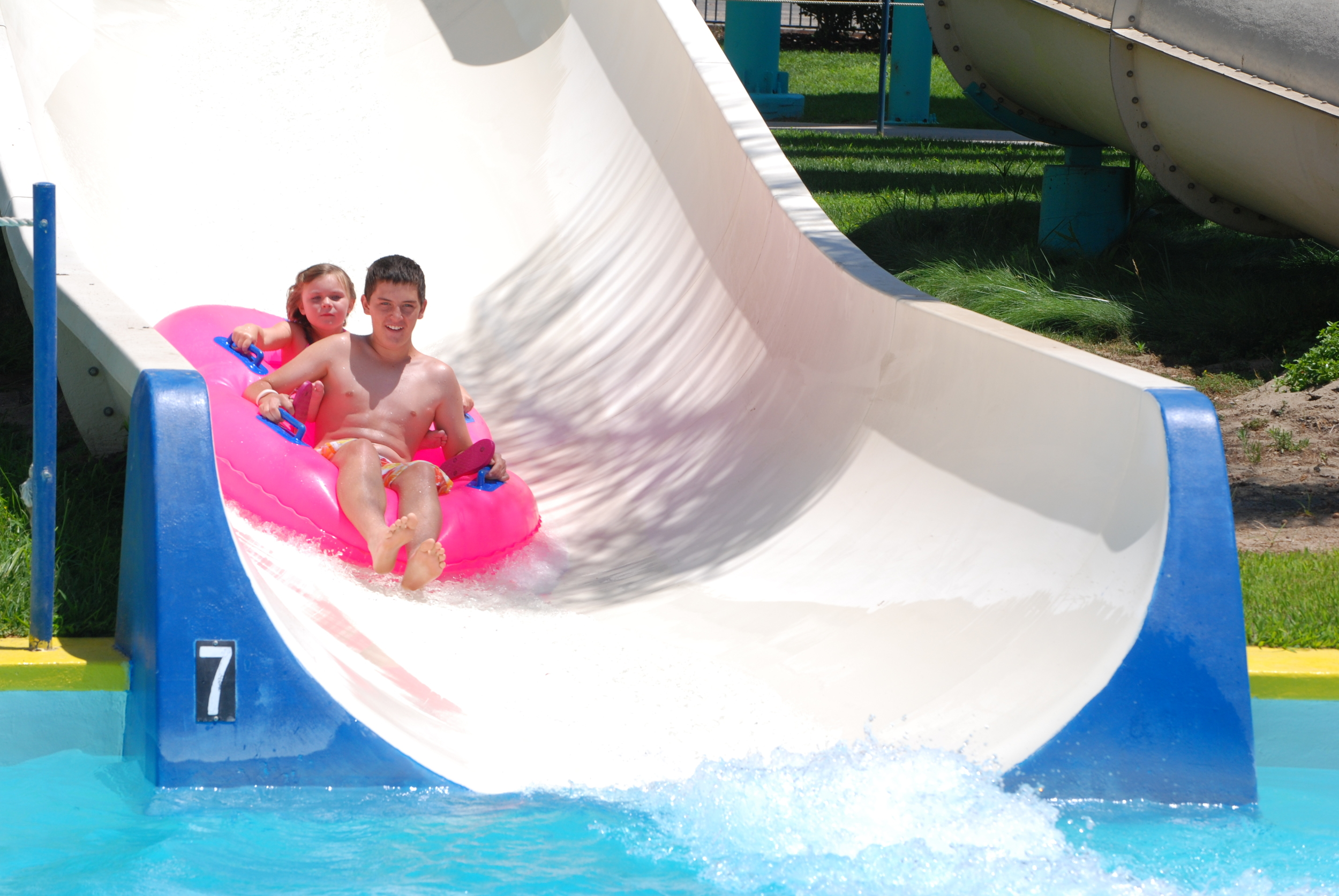 """Launching from the current of the RipTide surf pool, The Flusher sends riders splashin' straight into The Nile River. This attraction requires a rental tube. Minimum Rider Height: 48"""""""