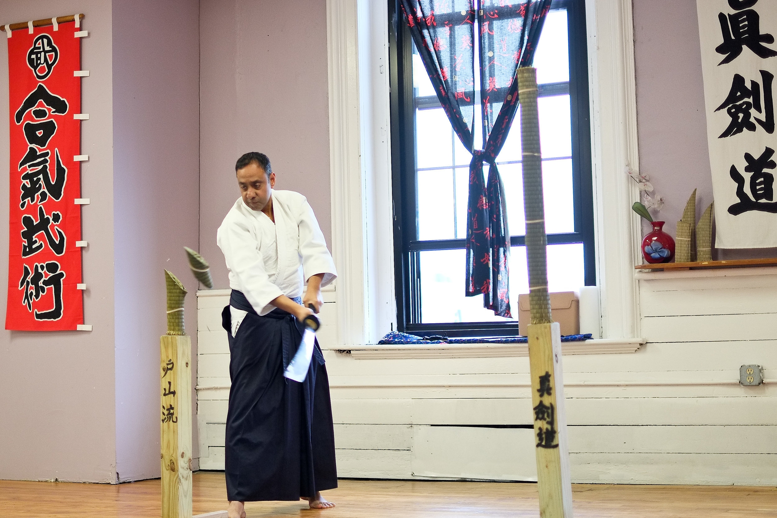Sensei shaffee bacchus, shinkendo boston shibucho, masterfully demonstrates tameshigiri (試し切り, test cut) with a live blade.