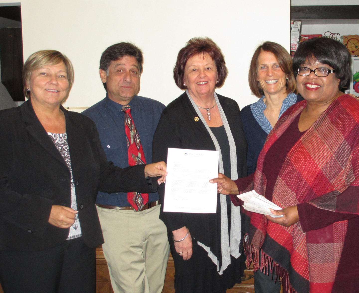 Stacy Newgaard (Power of 100 SW), TLC board chair Jeff Di Gregorio, Irene Kelly andJane Donahue (Power of 100 SW), and TLC Executive Director Lucy Zanders at the check presentation on May 18, 2015.