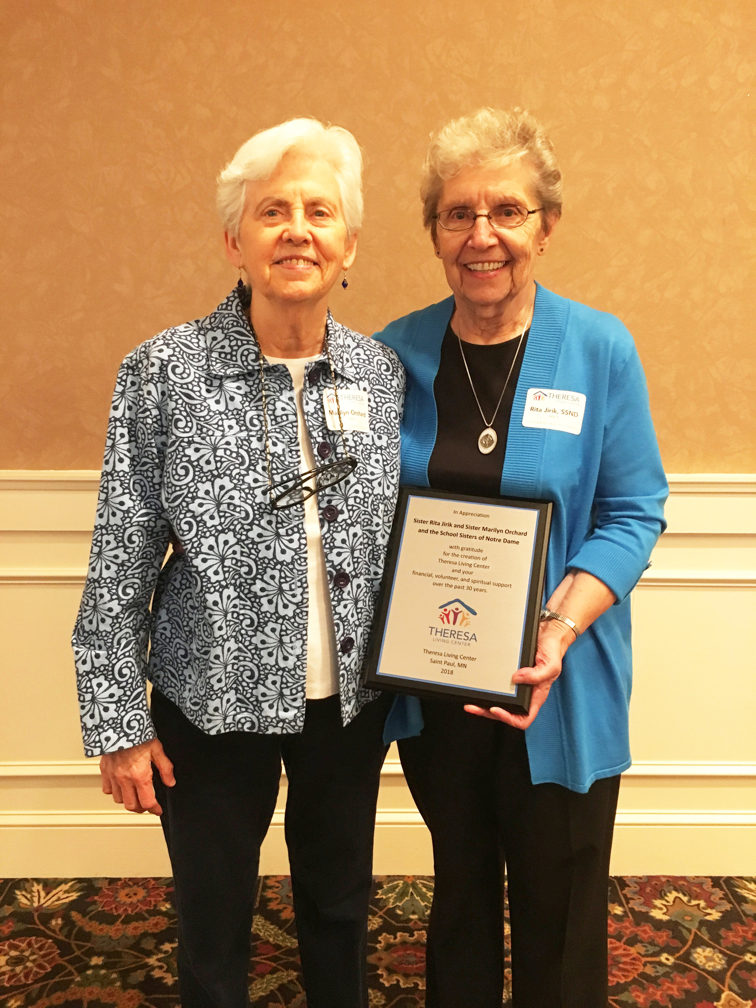 Sisters Marilyn Orchard and Rita Jirk, SSND, our two founders. They were presented with a plaque acknowledging the SSND's role in the creation of Theresa Living Center in 1988 and their generous ongoing support in time, financial assistance, and talents.
