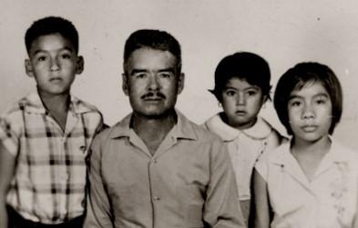 Nine-year-old Juan Palma with his father epifanio and sisters Maria Elena and aida