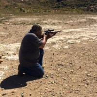 lupe (above) and Alexis (Right) sighting rifles before elk hunt, 2015