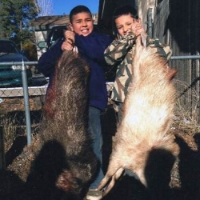 Lupe's grandsons, Matthew and Angelo, with javelina