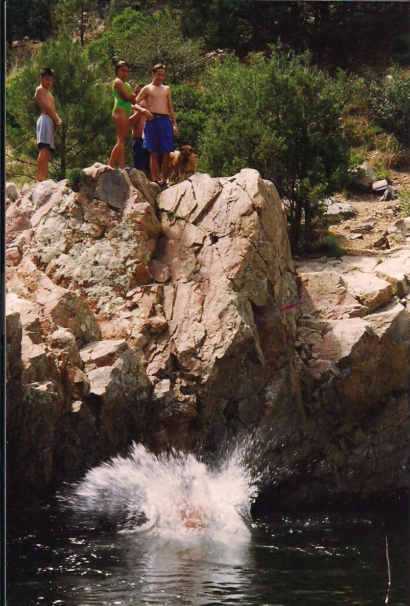 Kids jumping into the Pecos River