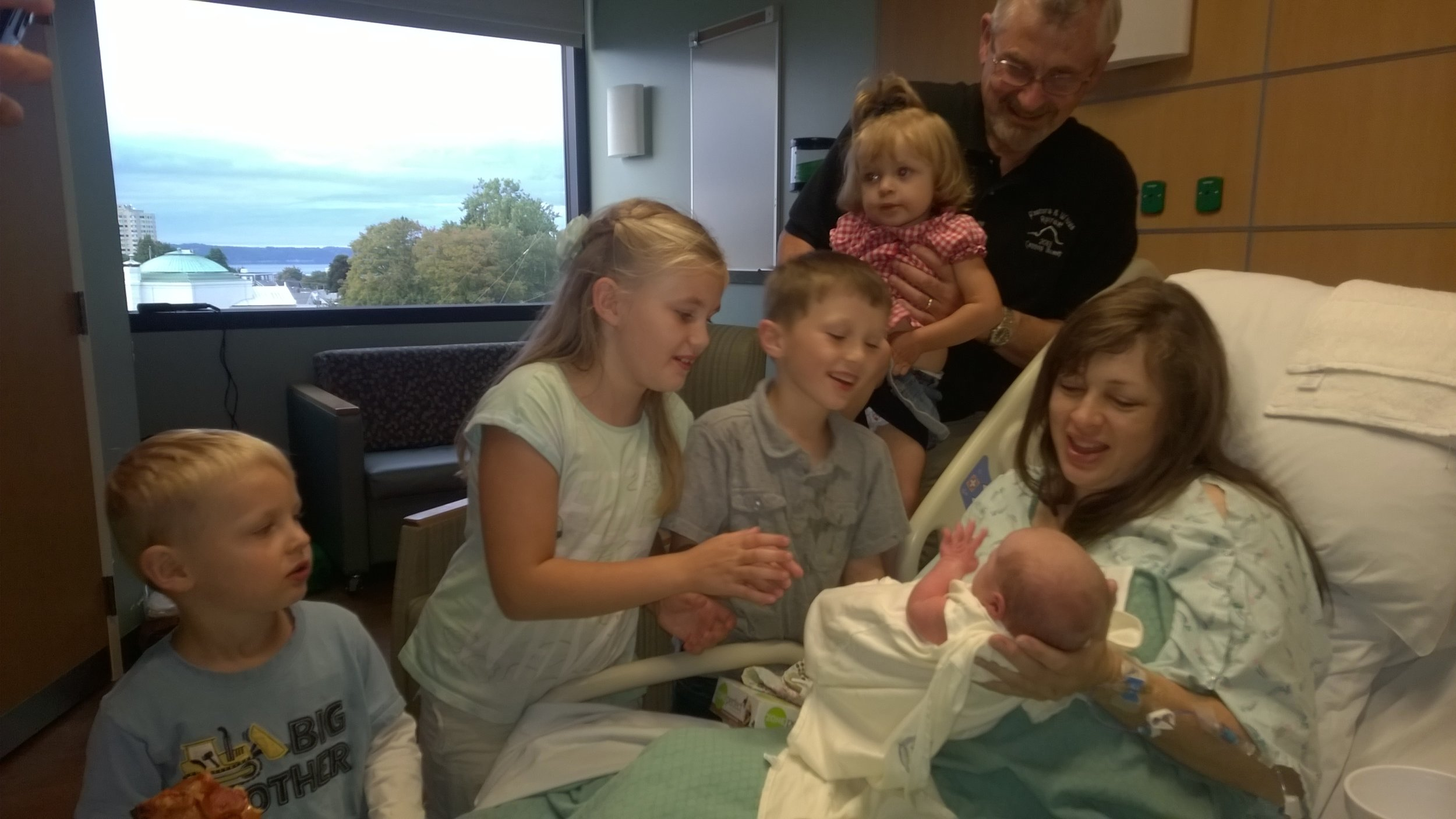 Little Titus James meets his brothers & sisters and grandpa for the first time.