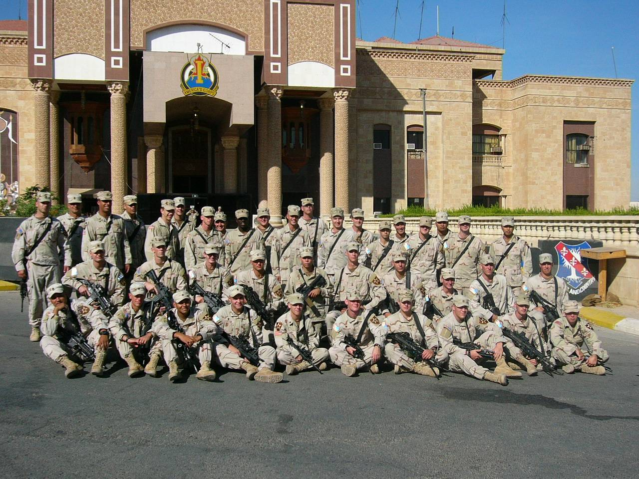 Sgt. De Roo with our US troops in front of one of Saddam Hussein's palaces.
