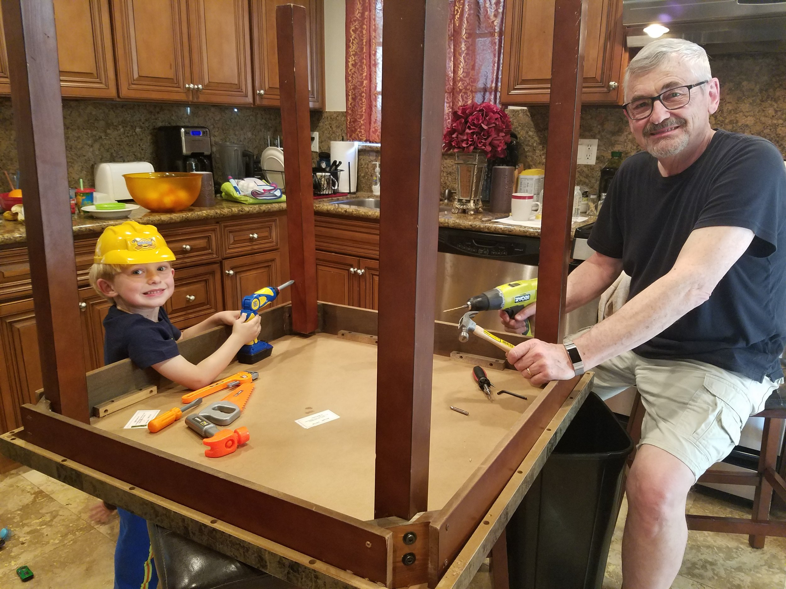 Pictured here--real happiness and joy; Noah helping Grandpa and Grandpa helping Noah.