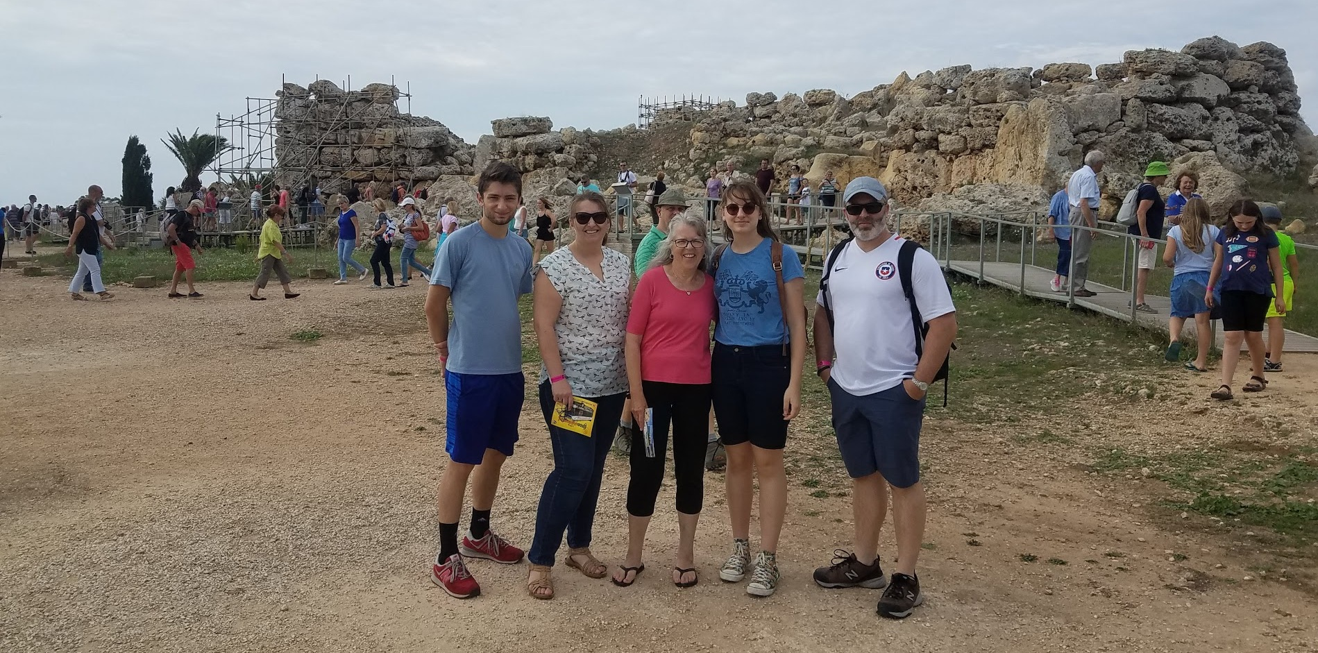Behind family are the Megalithic Temples of Malta. They are UNESCO World Heritage Sites because they are the oldest free-standing structures in the world built 5,600 years ago. These polytheistic people may have been the ancestors of those Paul encountered. Picture LR: Mishael, Christina, Nancy, Noelle and Caleb Suko.