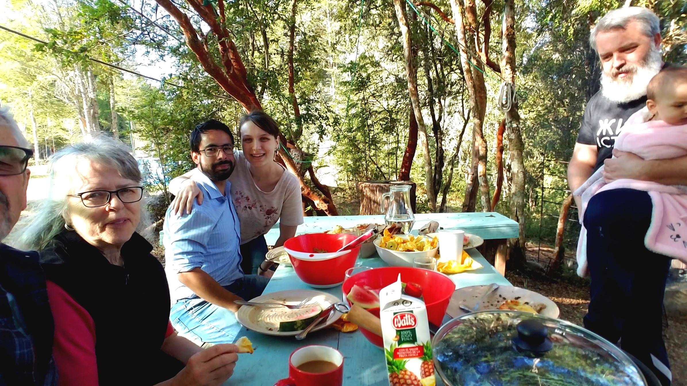 A relaxing lunch outside Naomi and Jorge's forest cabin with a babbling brook just feet away.
