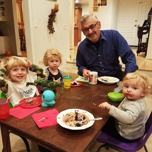 Grandpa enjoying a little birthday celebration with a few of the sweet grand kids.