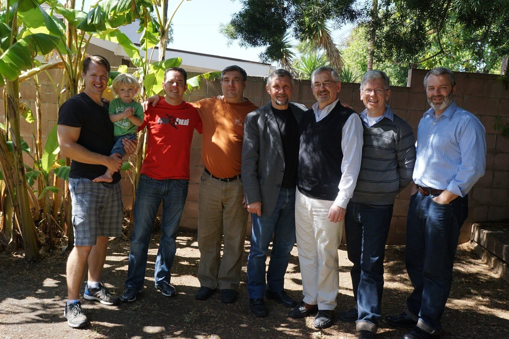 ABOVE: In LA at my son Ezra's home a few years ago during a Shepherd's Conference with some of our guys and Pastor Fedor Bespalov standing next to me.  BELOW: Praying for seven Ukrainian leaders who came through Russian check points safely in the Donetsk Region to the conference at Pastor Bespalov's  Light of the Gospel Church.