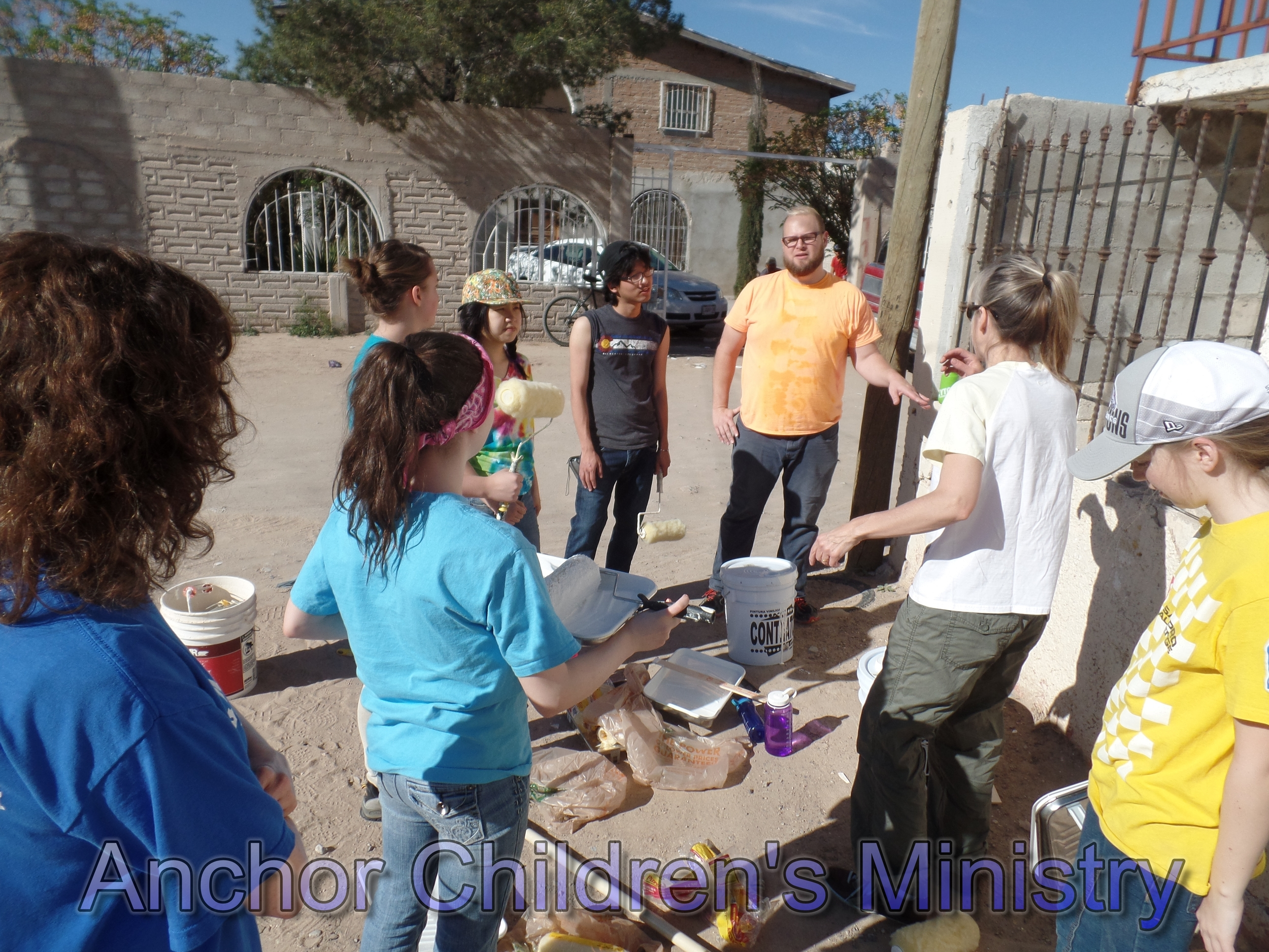 Christian Challenge team helps paint of the school's buildings 2014