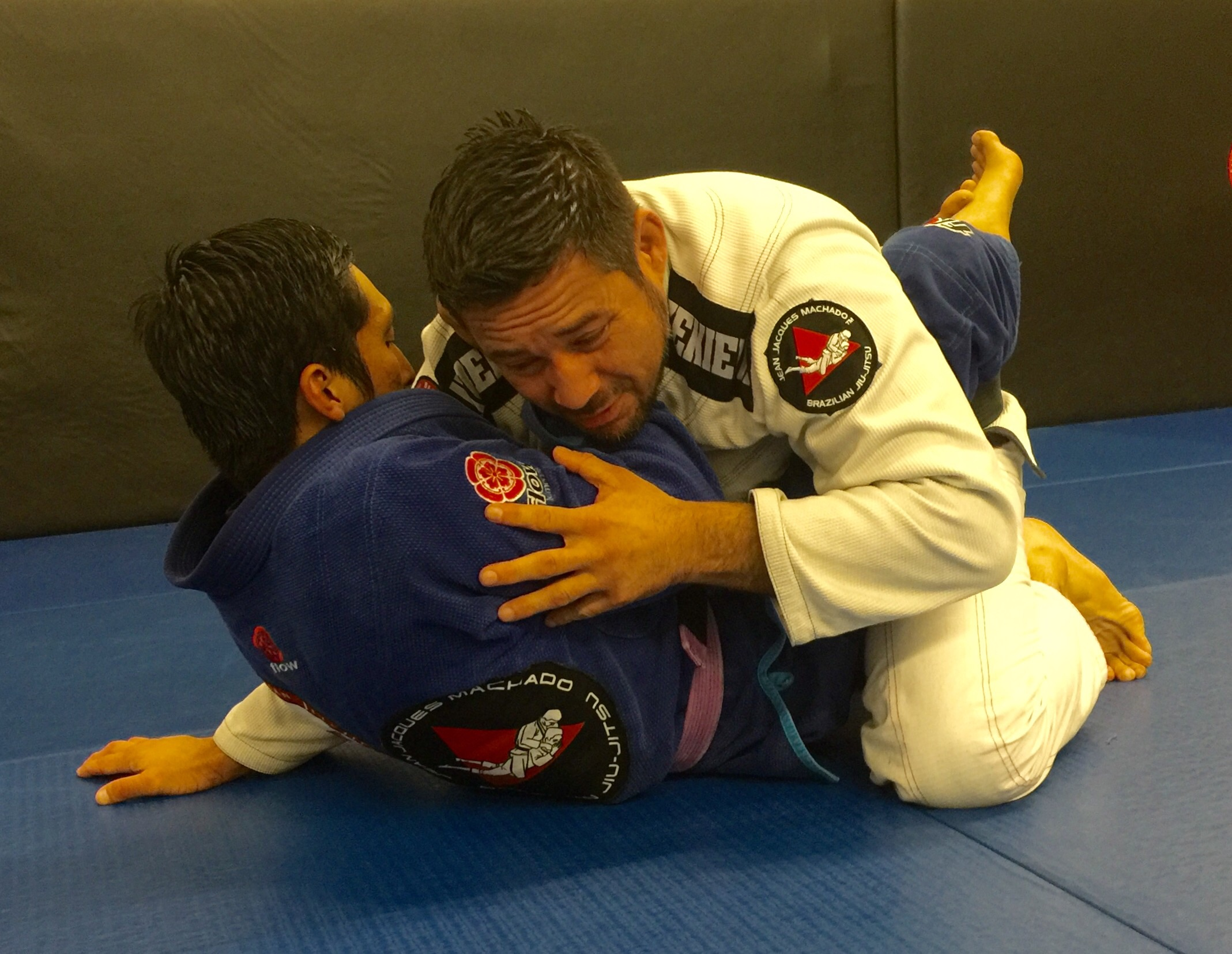 Caught in the trap! A Cross choke with your arm overhooked.