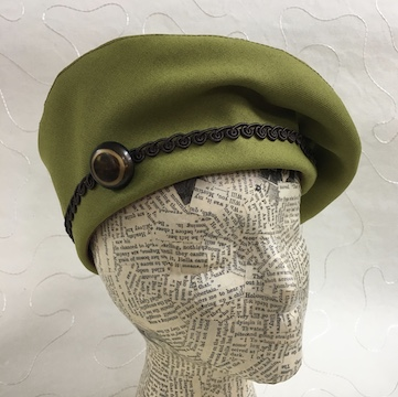 Flat pattern beret with vintage button.