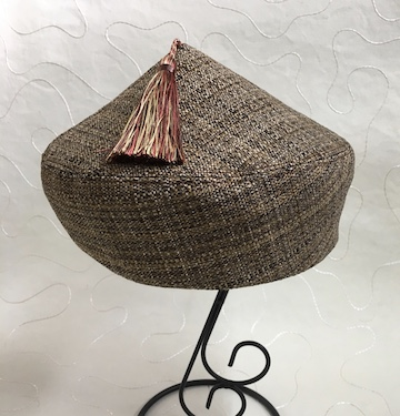Flat pattern peaked beret.