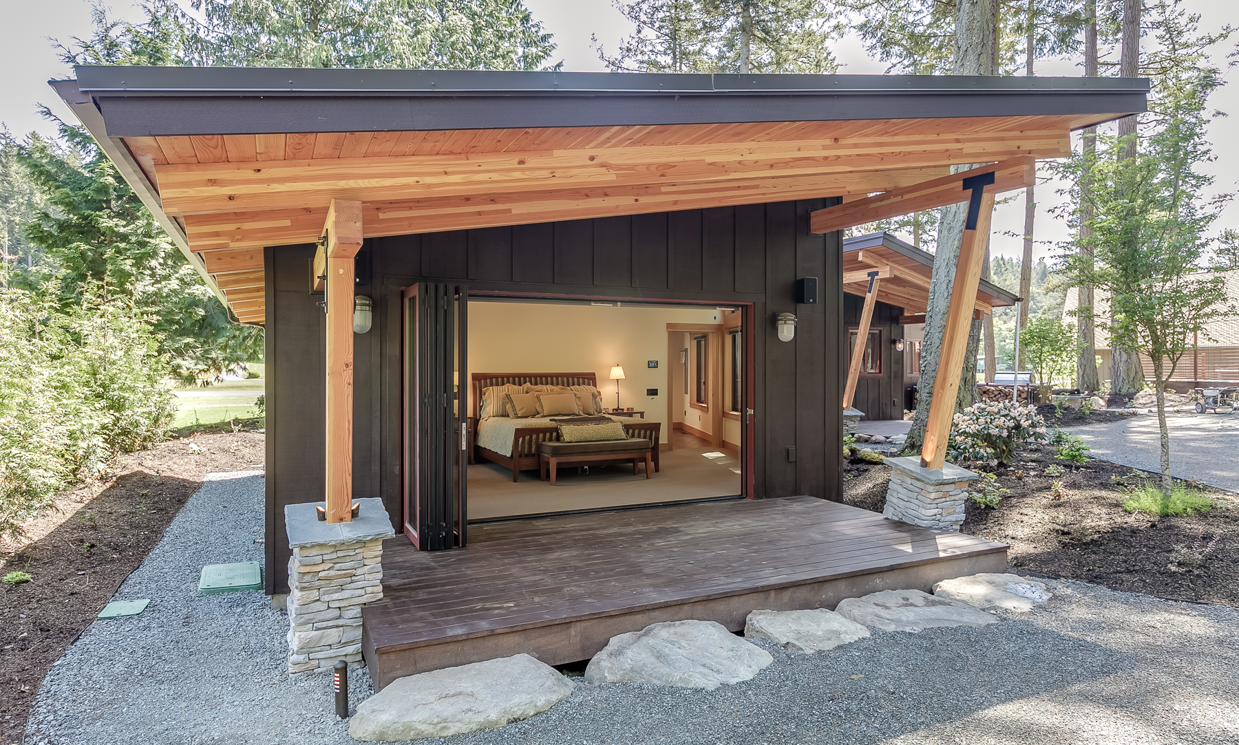 New Construction with jetting over hang on this Master Bedroom covered porch wing and folding doors open to bring the outside in.