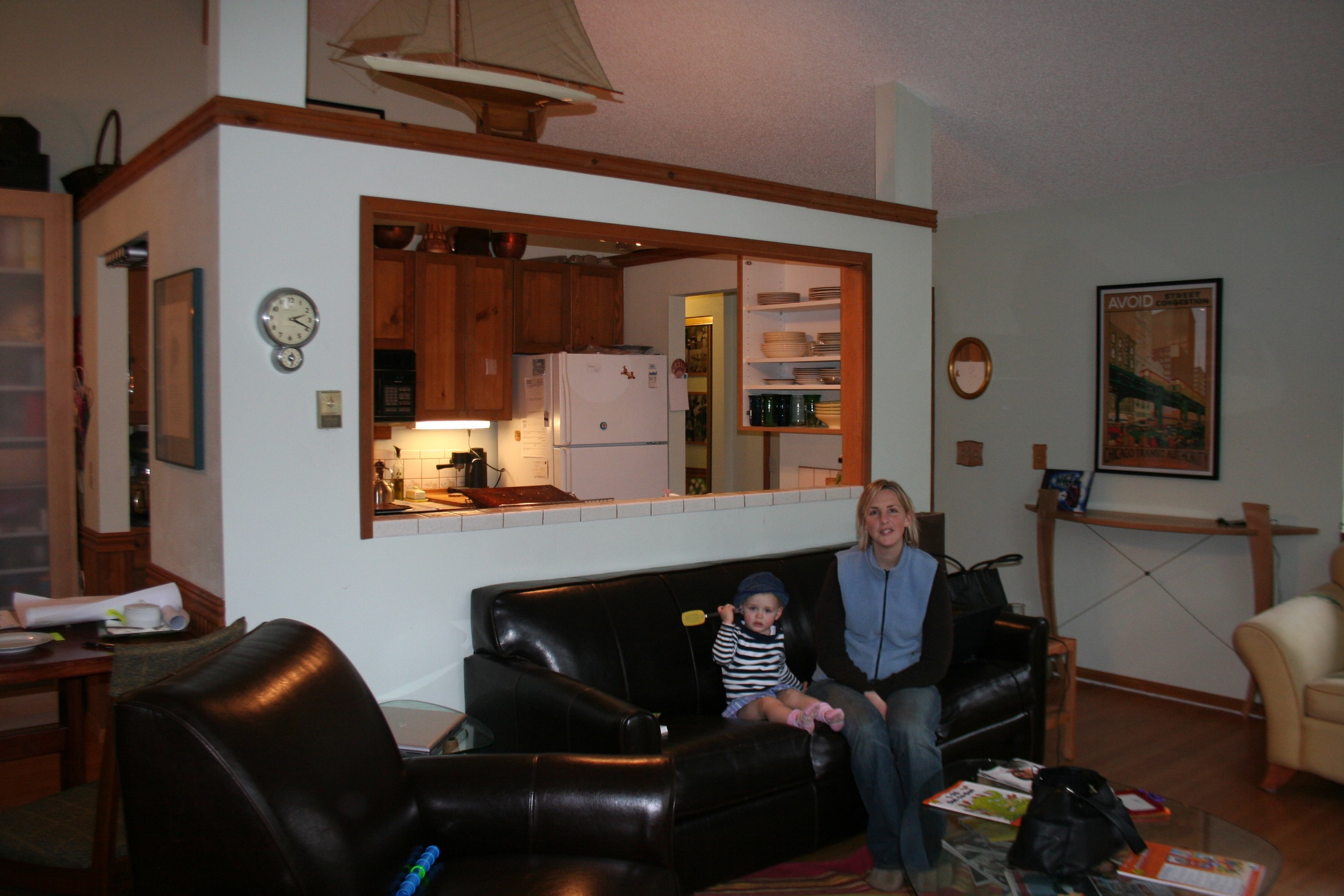 The kitchen before was inside the living room and a tiny cramped space walled off from the rest of the room.