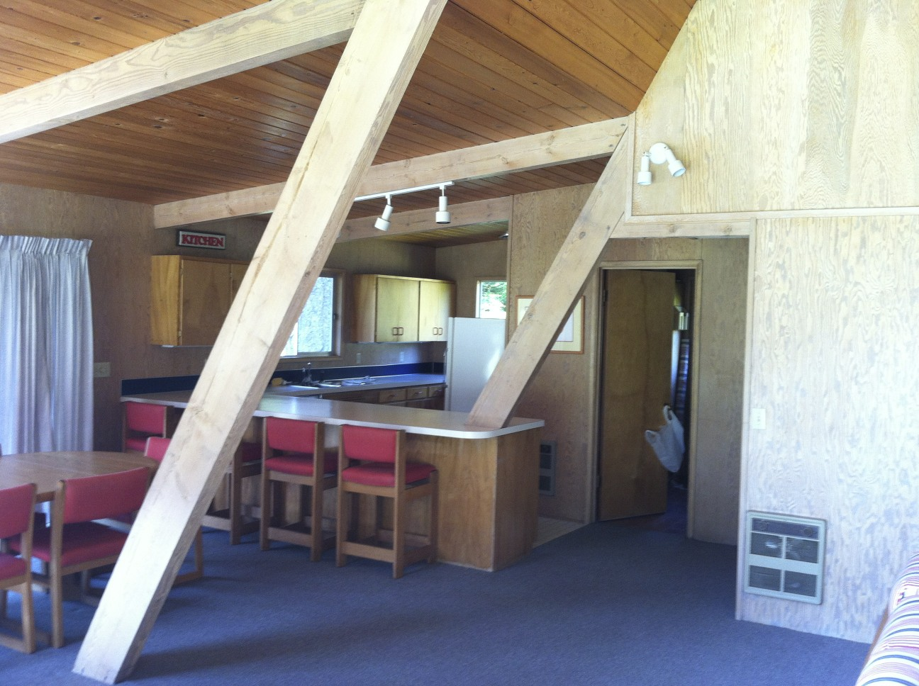 The kitchen was recesses behind the Aframe's roof beams