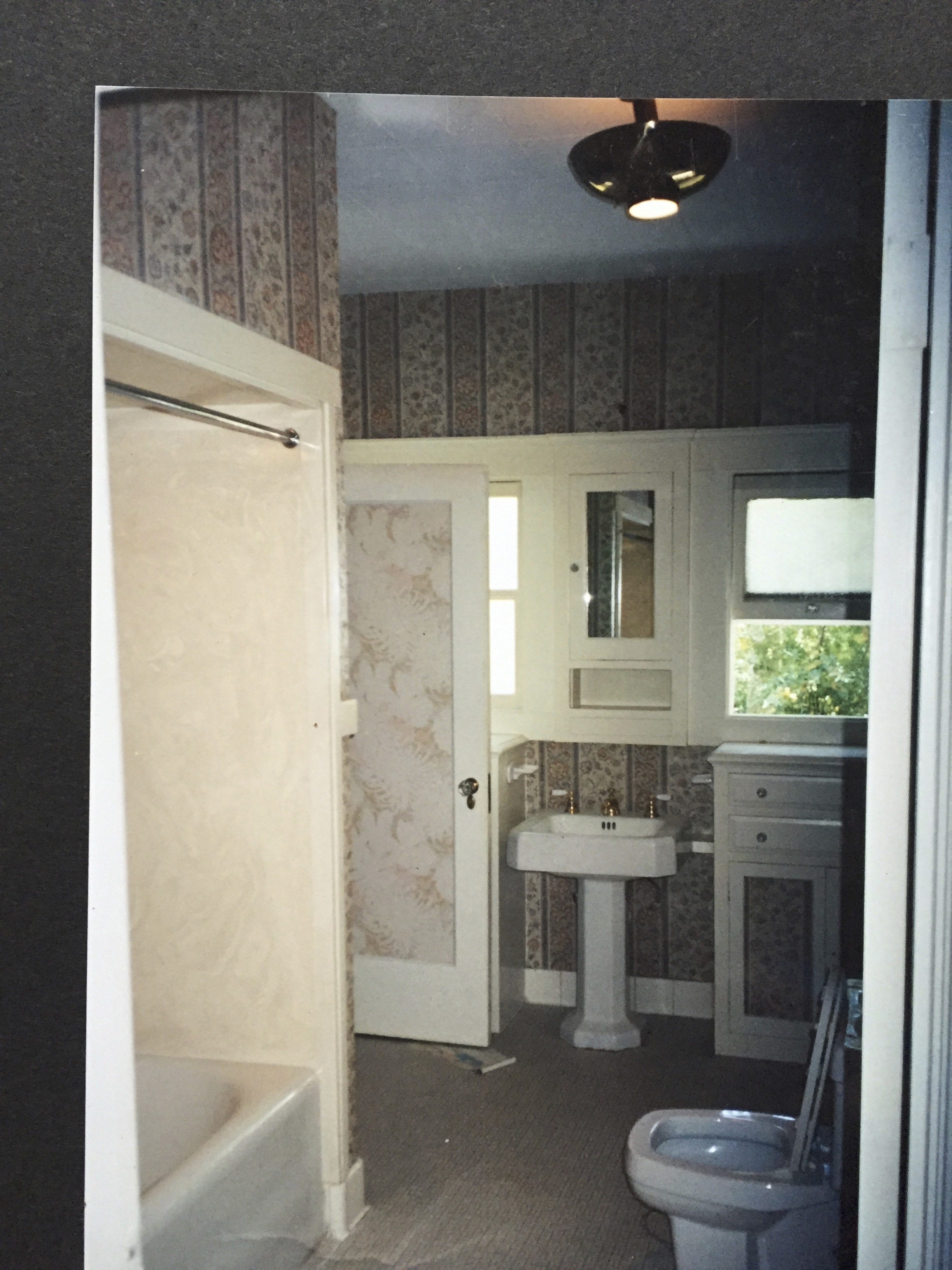 For some reason, in the old days, they would soffit down (drop the ceiling) over a shower to make it feel more cozy? Retain the heat?