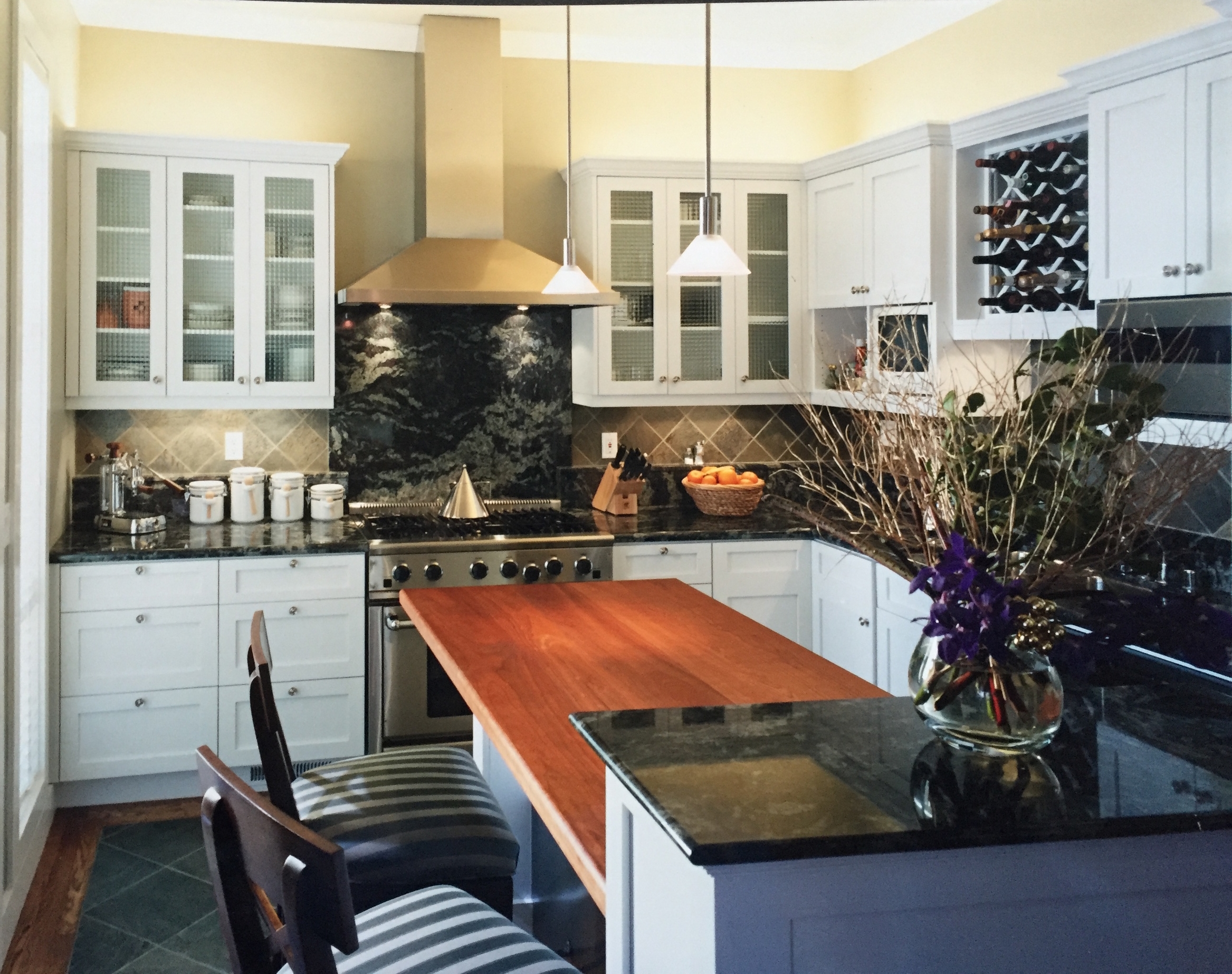 Up-lighting above the upper cabinets of this Victorian's kitchen remodel I did, gives the room a sense of being washed with light.
