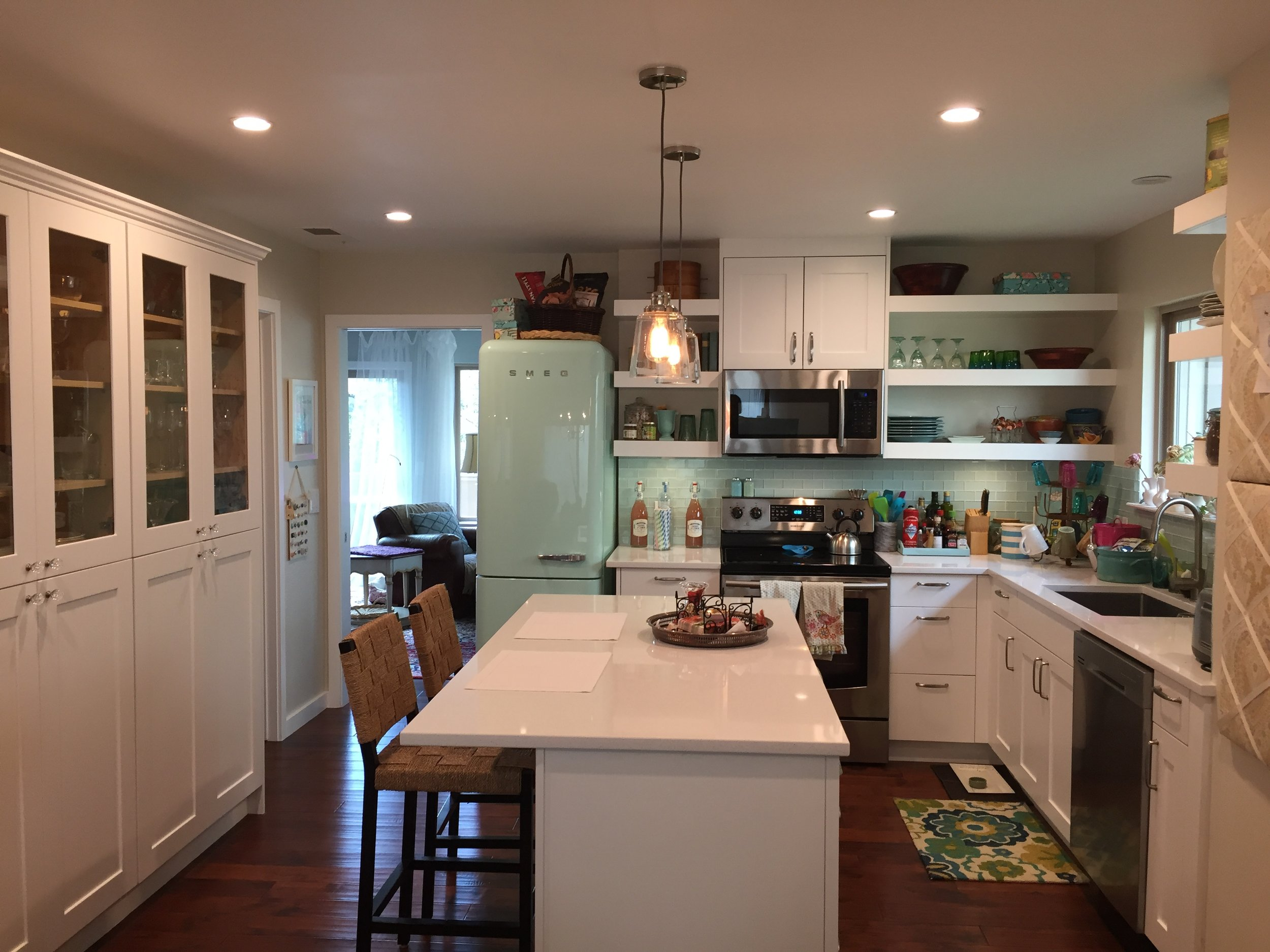 Modern Country with a SMEG cool green refrigerator....wall was removed to open up the kitchen to the dining room.