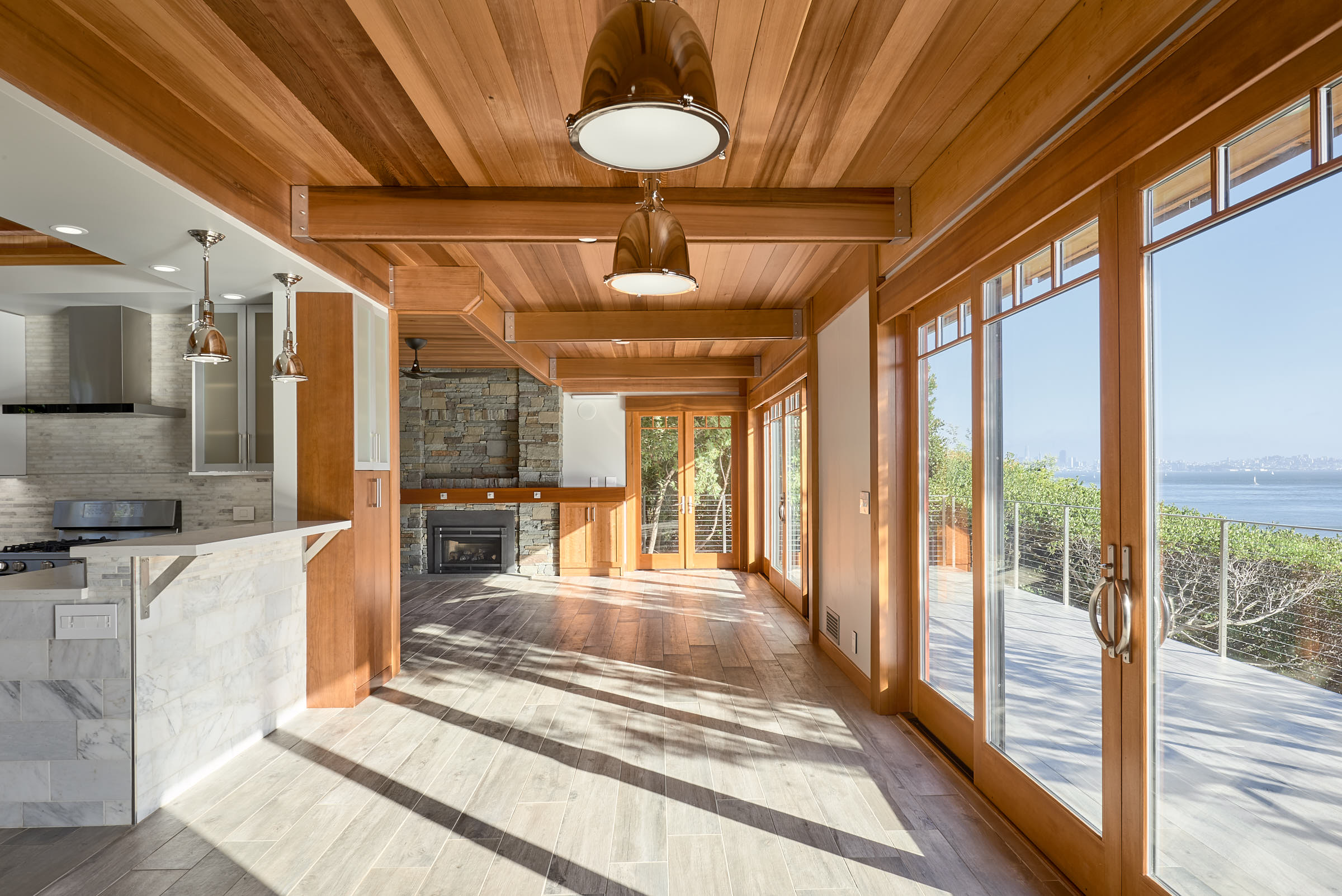 Now you can see the view from the kitchen is pretty spectacular. Porcelain tile Floors throughout continue onto the deck.