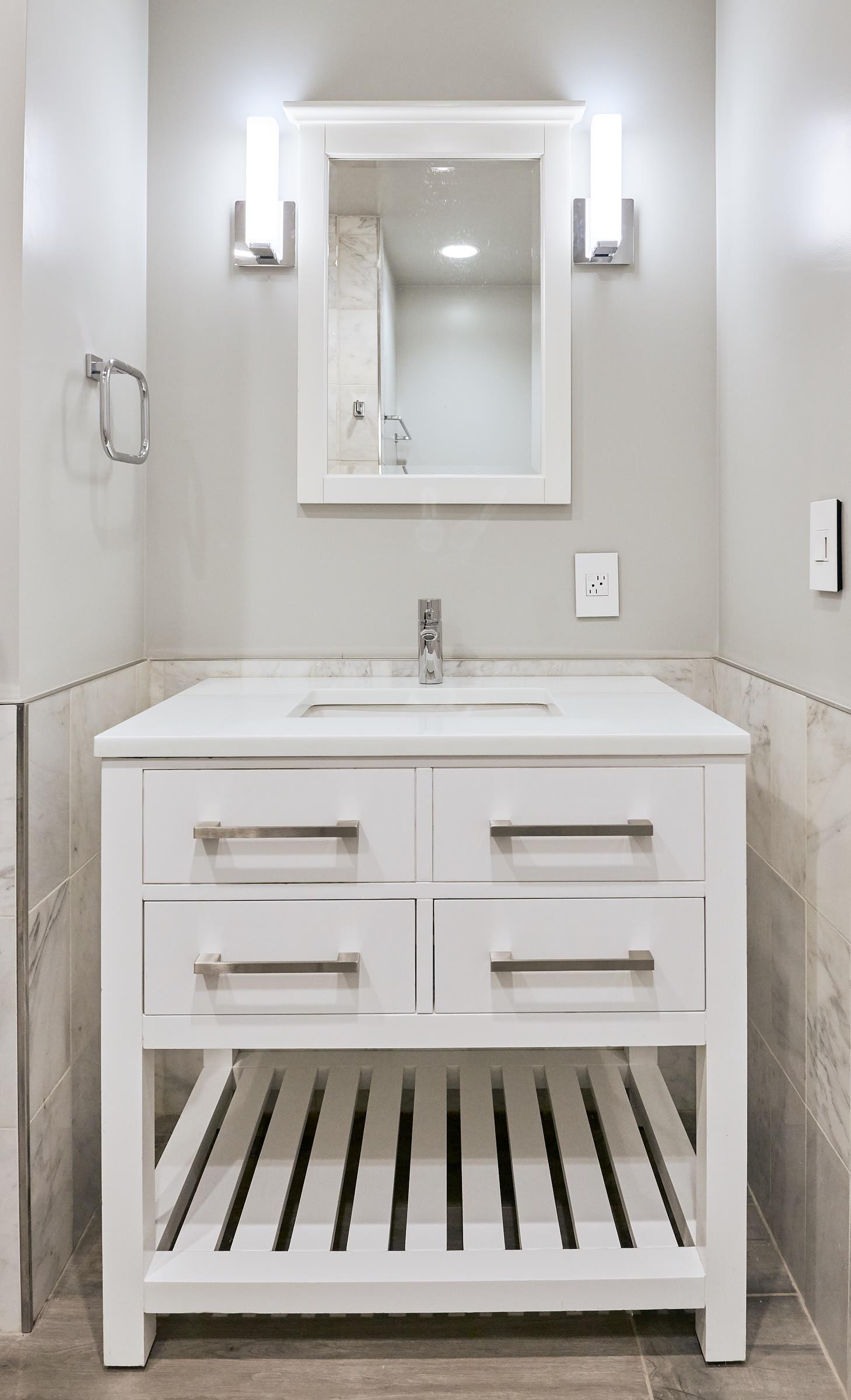 White Carrera Marble tiles, White Quartz Counter, White Cabinet all make for a classic bathroom.