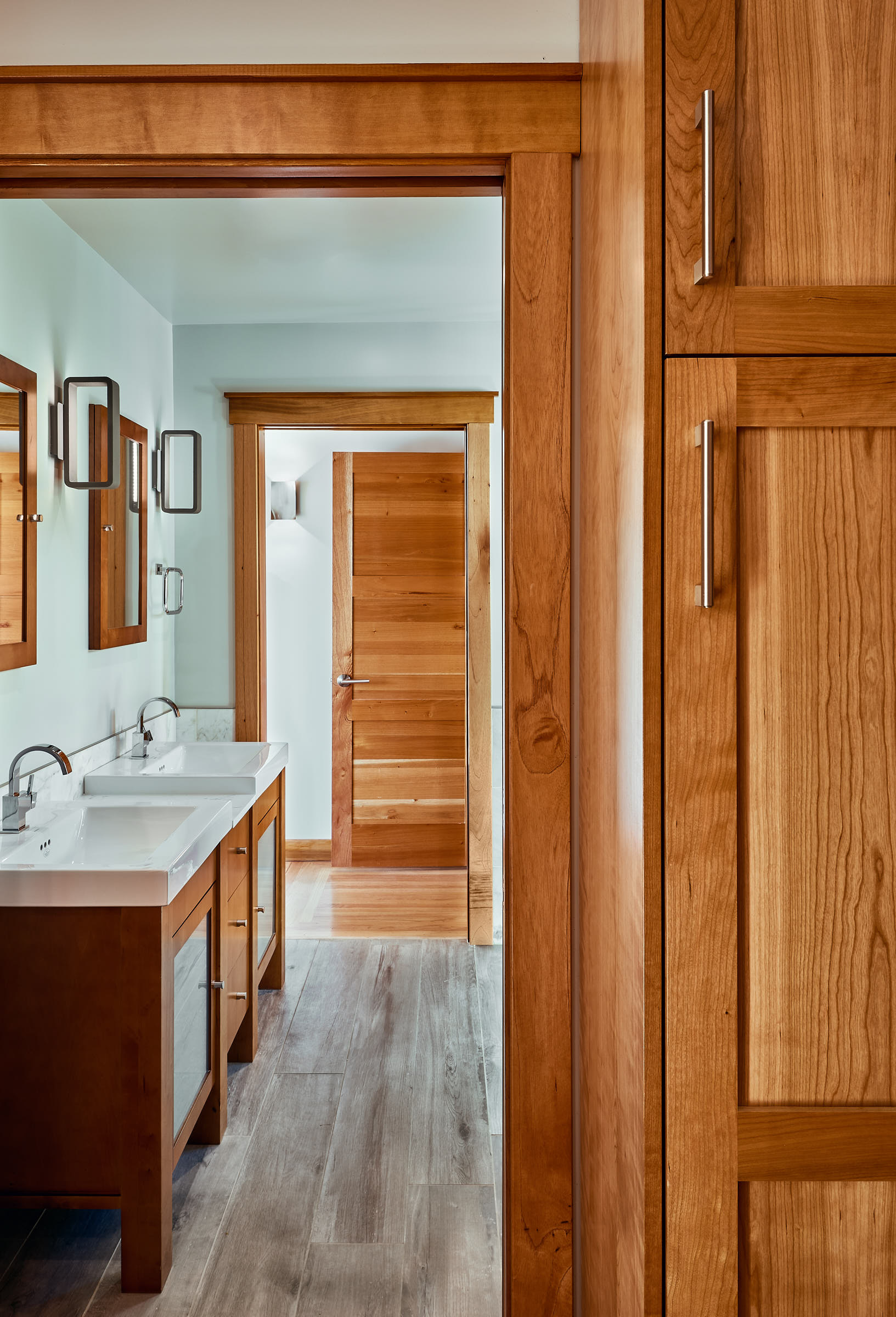 The warmth of the Spanish Cedar doors and cabinets, accent the Grey Porcelain Tiles in this Master Bathroom.