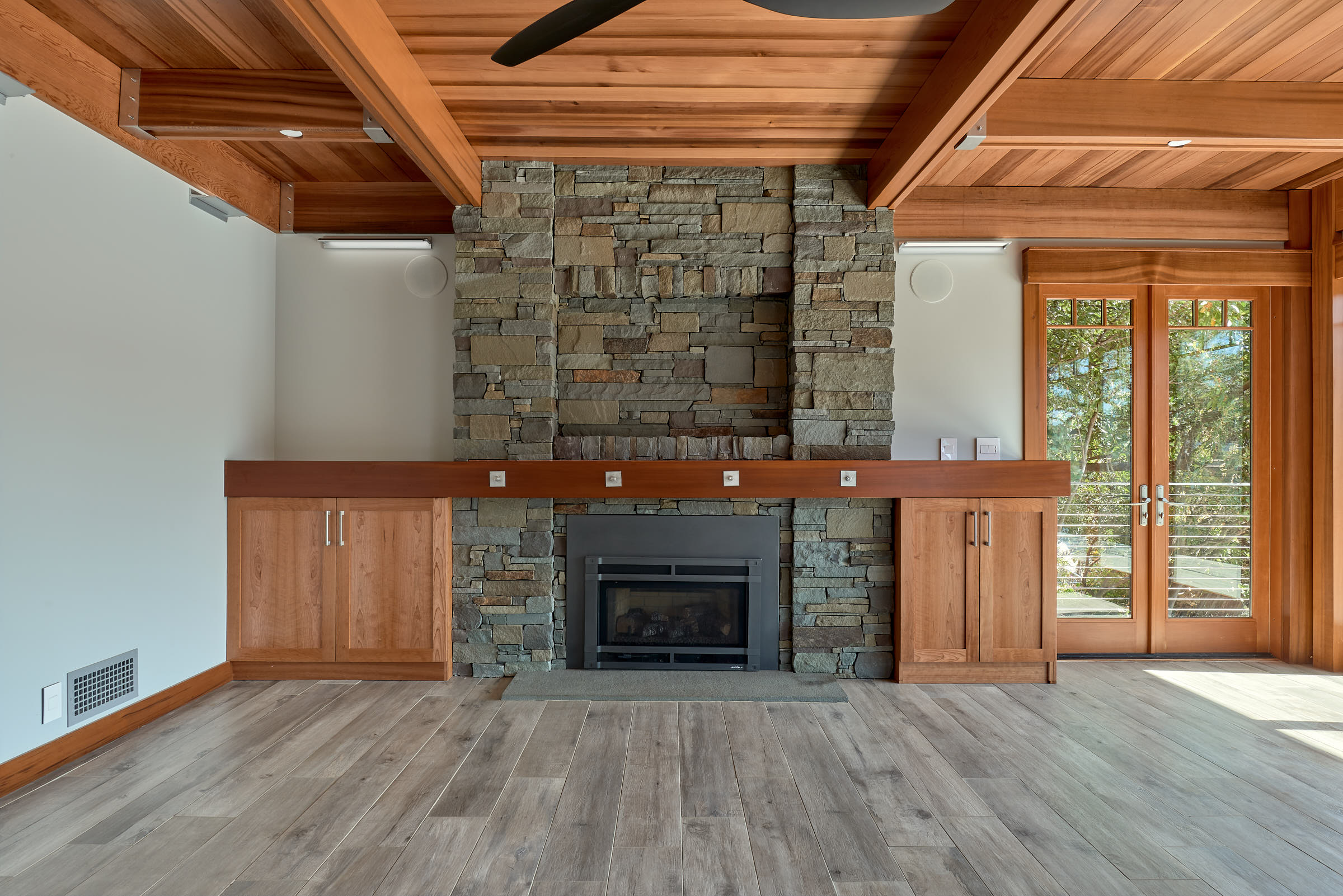 The Fireplace is the heart of this home with built in storage for audio.