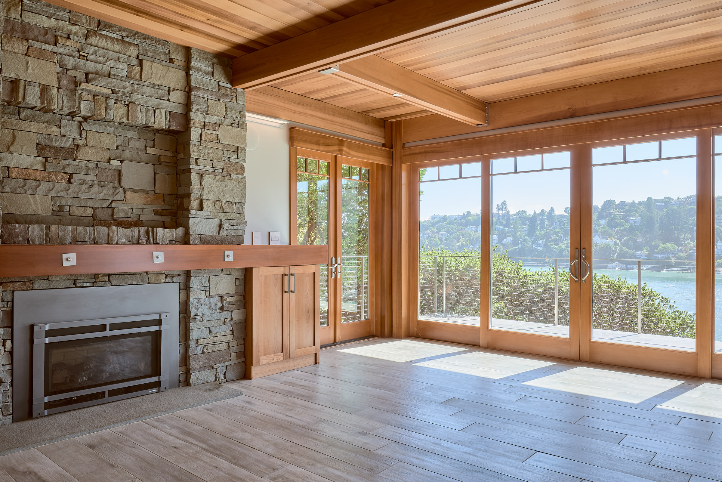 The Fir beams and ceiling lend a warm contrast to the stone.