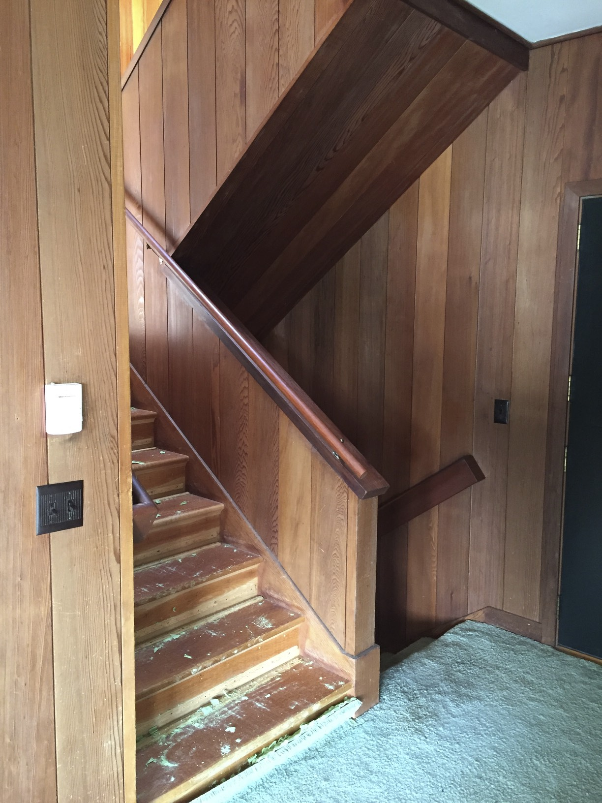 Even though the stairway before had original redwood paneling from 1954, it was tired looking. It was all enclosed and dark feeling.