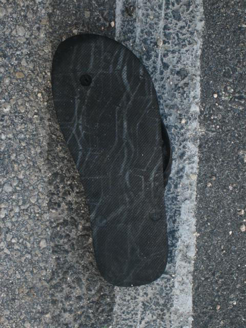 """Tire on Sandal (Wynwood, Miami, FL.), 2008. From the series """"Found Objects""""."""