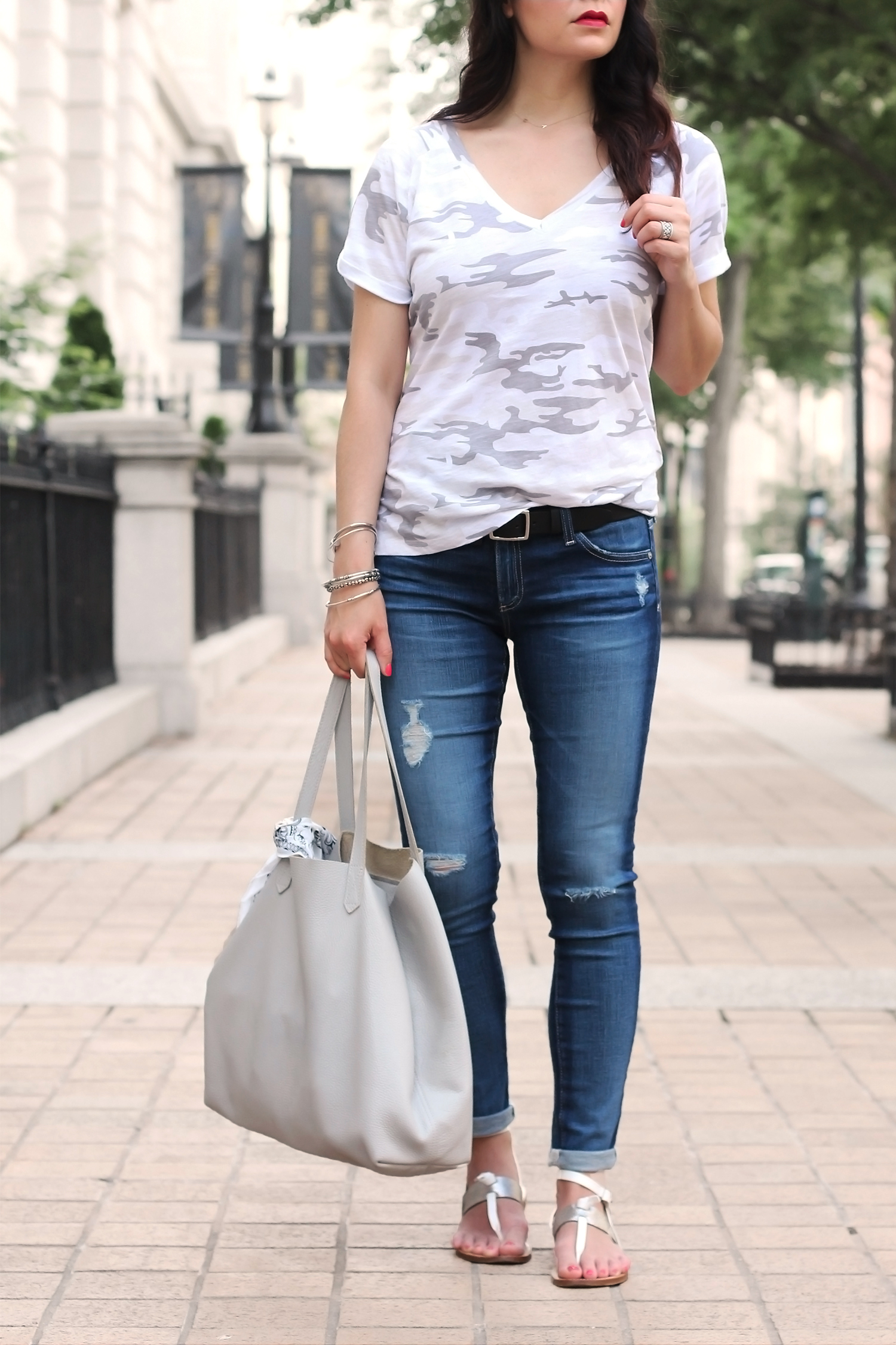 Distressed jeans and sandals