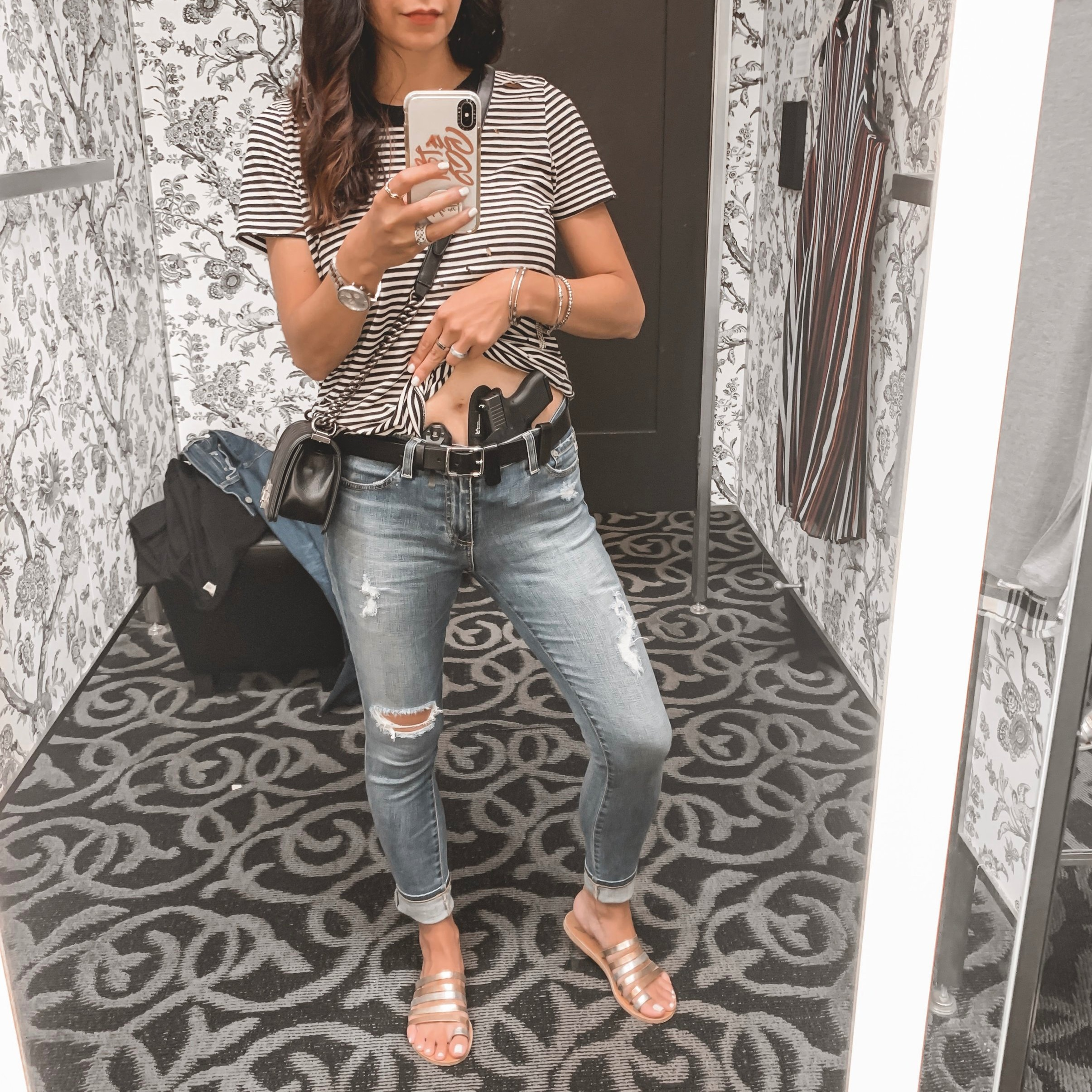 — Outfit Details — n:Philanthropy Shirt  {   similar   }    AG Jeans  {   similar   }    Ancient Greek Sandals  { similar }    Chanel Handbag    — Concealed Carry Details —  Self-Defense Tool:  Glock 43    Holster:   StealthGearUSA Ventcore AIWB  *   Flashlight:   SureFire Stiletto     Belt:   Rag and Bone   (*use code SMT10 for 10% off at   stealthgearusa.com  )