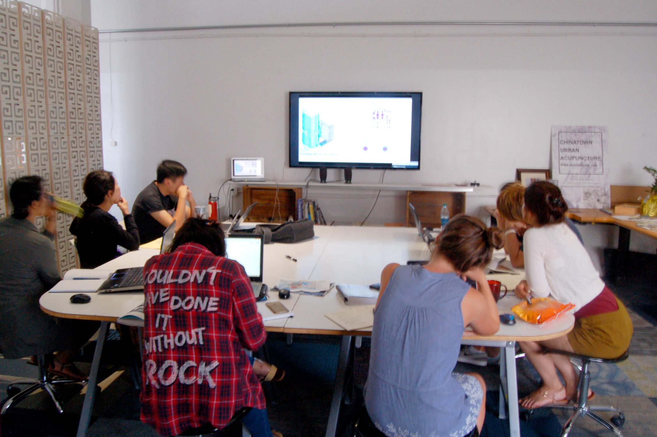 SHADE interns listening to Aaron Vorwerk discuss the Autodesk InfraWorks 360 program